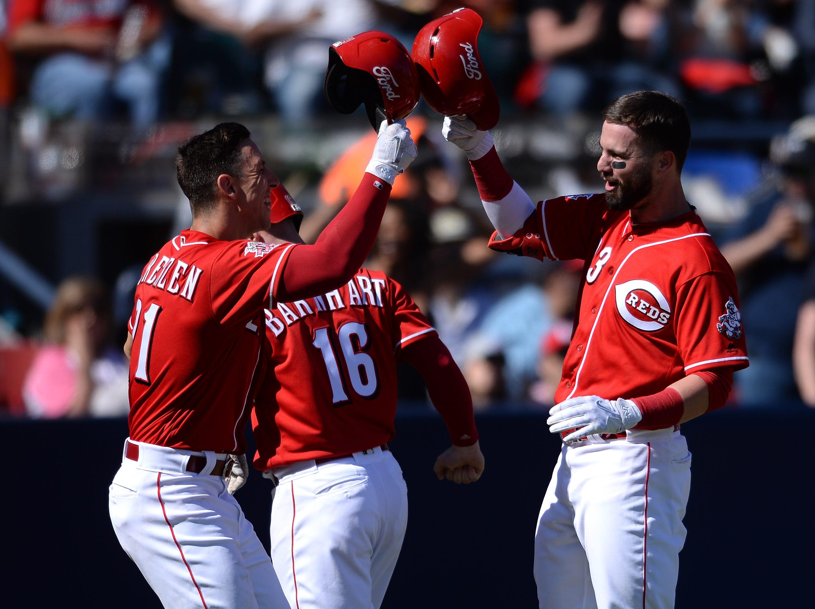 Cincinnati Reds left fielder Jesse Winker (33) is congratulated by relief pitcher Michael Lorenzen (21) after hitting a three run home run during the fifth inning against the St. Louis Cardinals at Estadio de Beisbol Monterrey.