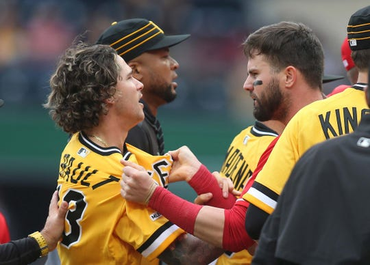 Pittsburgh Pirates relief pitcher Steven Brault (43) and Cincinnati Reds left fielder Jesse Winker (R) argue during a benches clearing altercation between the teams during the fourth inning at PNC Park.