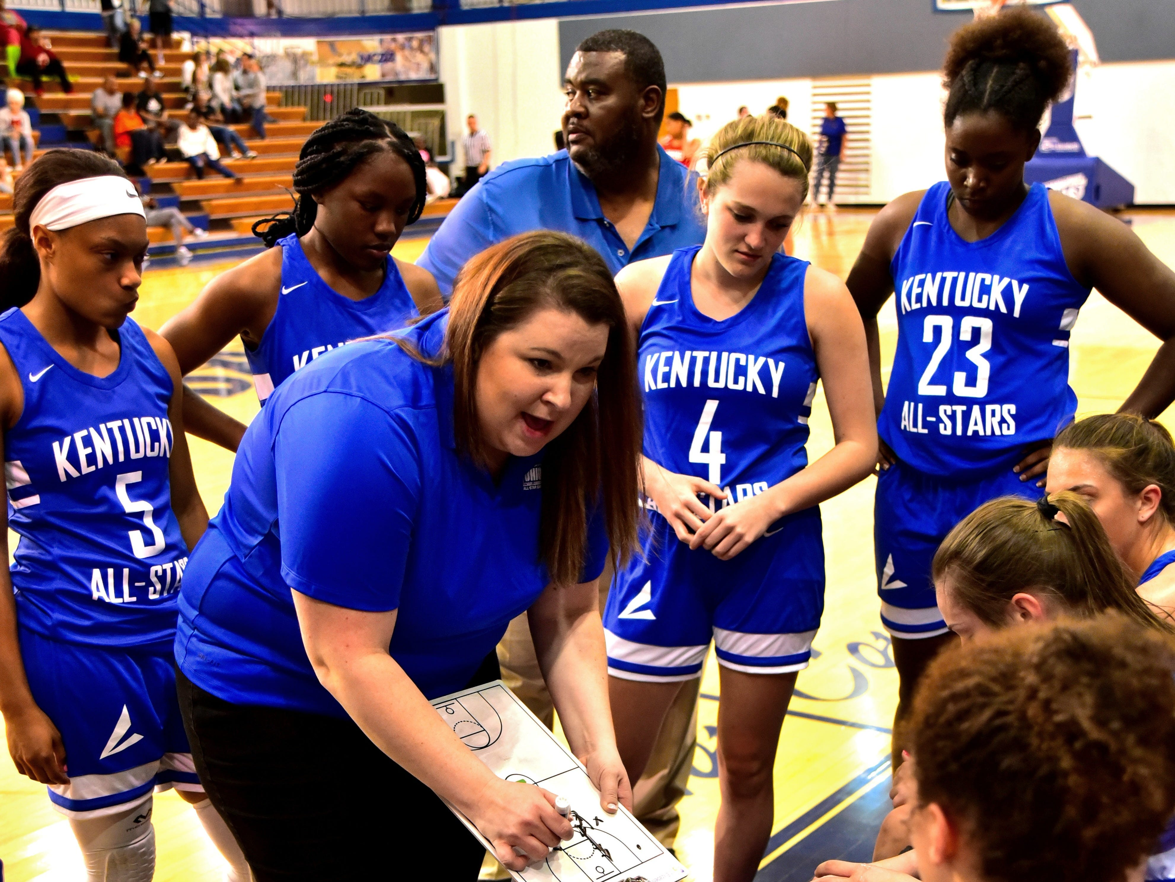 Ryle head coach Katie Haitz, serving as the Kentucky girls team head coach, offers some offensive direction during a time out at the 28th Annual Ohio-Kentucky All Star Games played at Thomas More University, April 13, 2019
