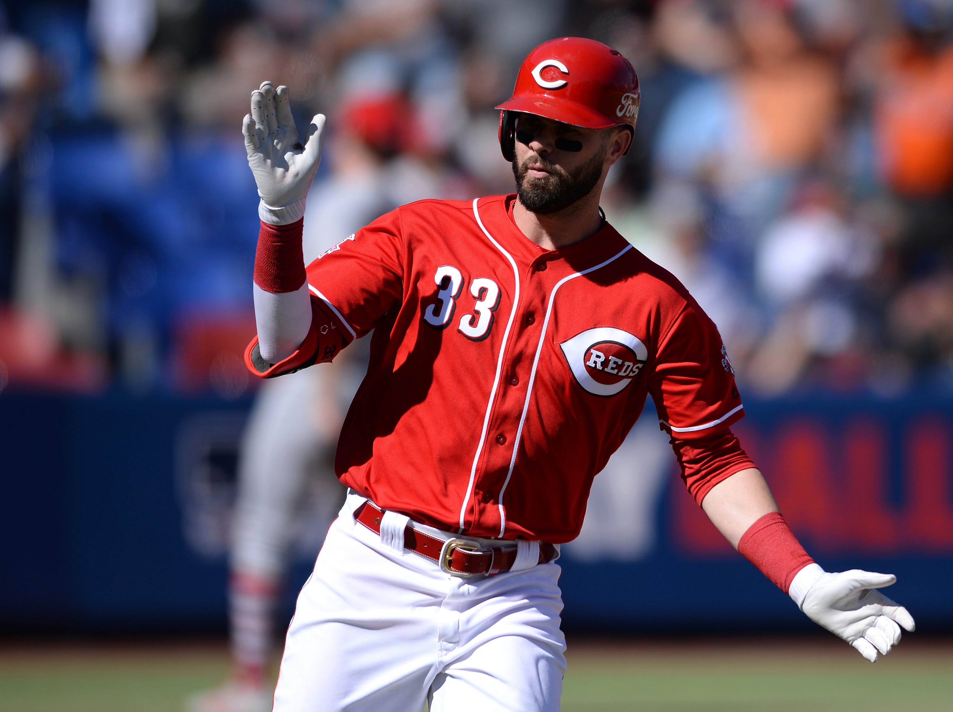 Cincinnati Reds left fielder Jesse Winker (33) reacts as he rounds the bases after hitting a three run home run during the fifth inning against the St. Louis Cardinals at Estadio de Beisbol Monterrey.