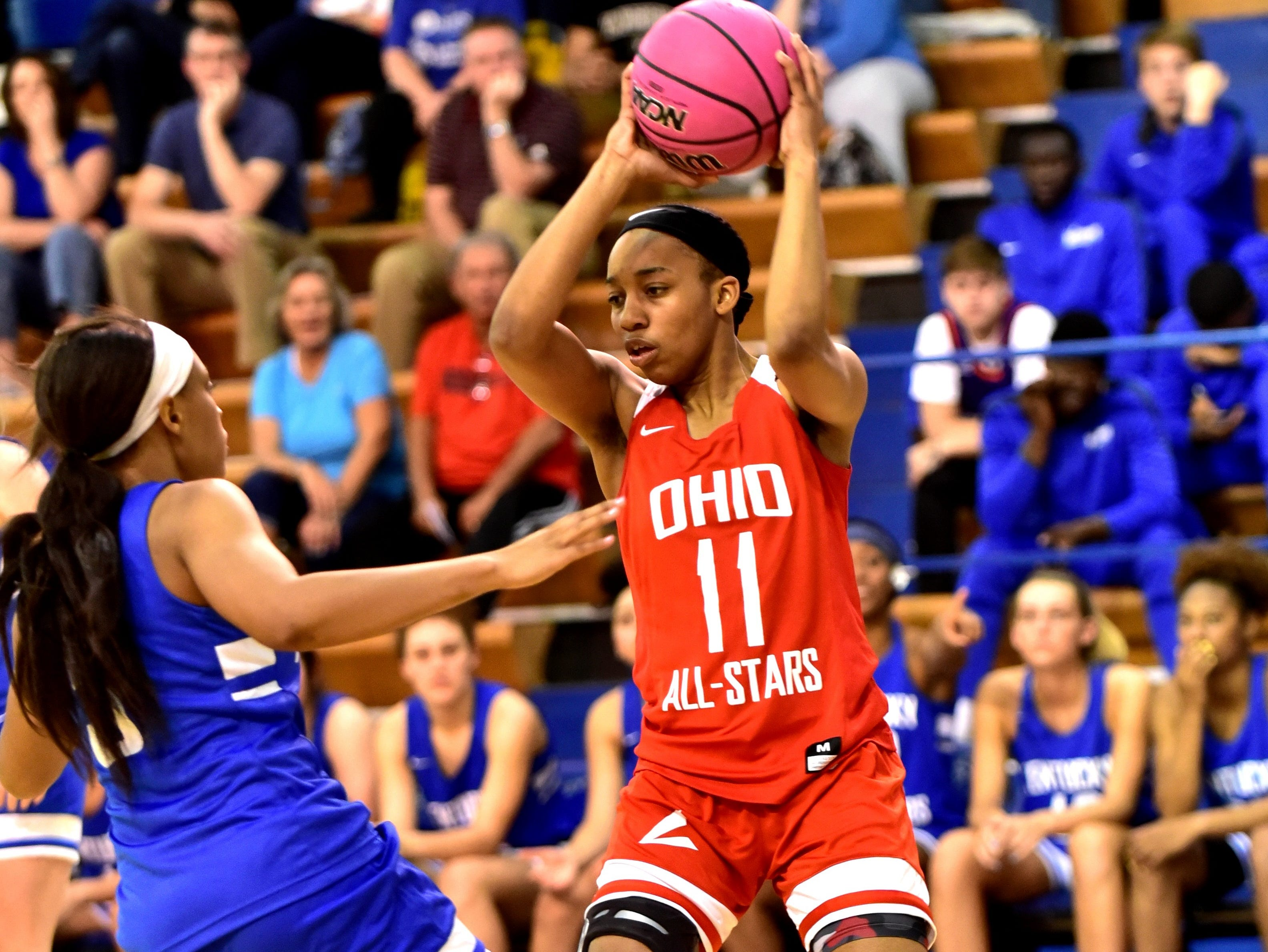 Dominique Camp (11) of Lakota West looks to pass out of a defensive jam for the Ohio girls team at the 28th Annual Ohio-Kentucky All Star Games played at Thomas More University, April 13, 2019