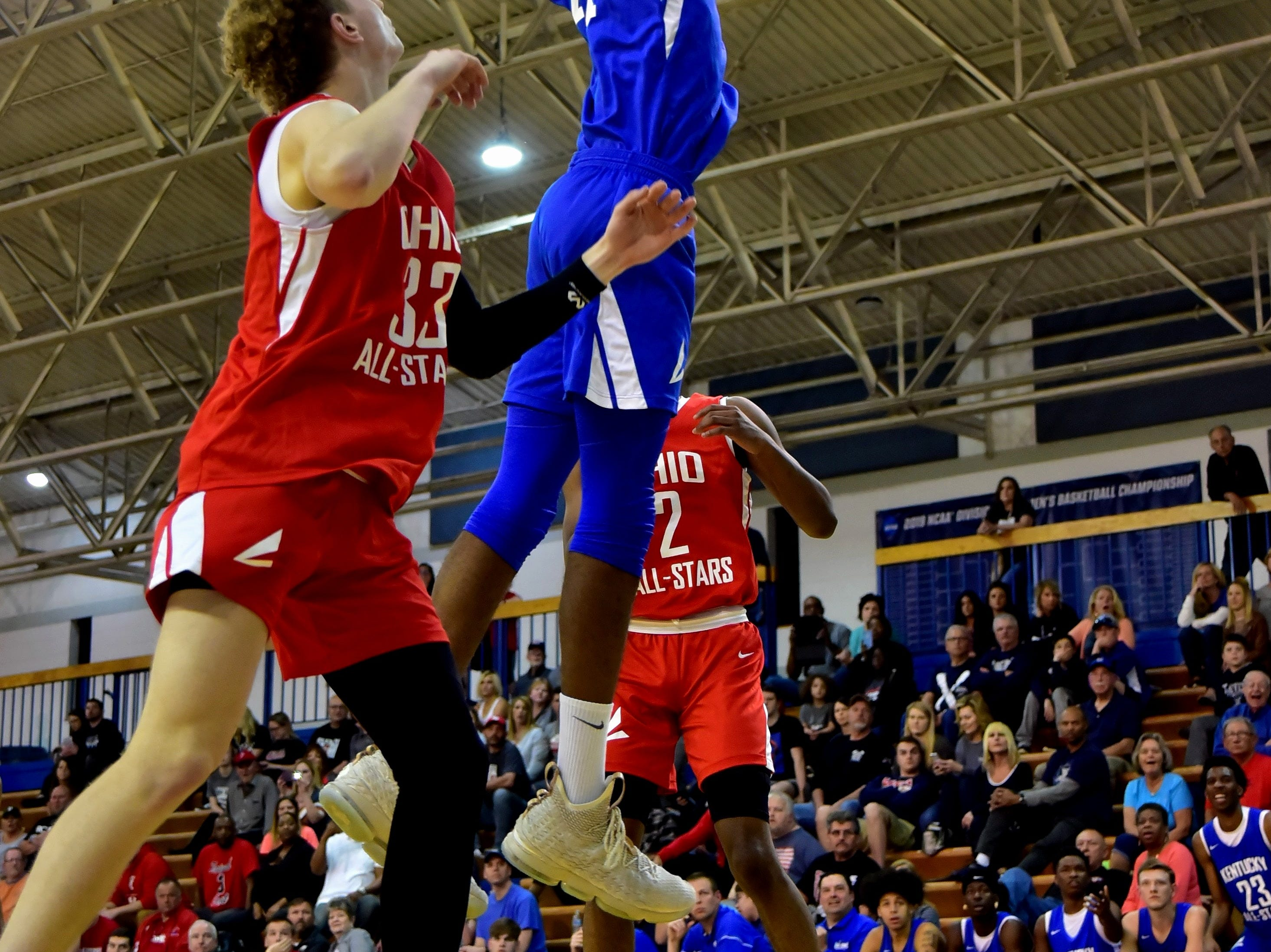 Dieonte Miles of Walton-Verona slams back an offensive rebound for a Kentucky boys team score at the 28th Annual Ohio-Kentucky All Star Games played at Thomas More University, April 13, 2019