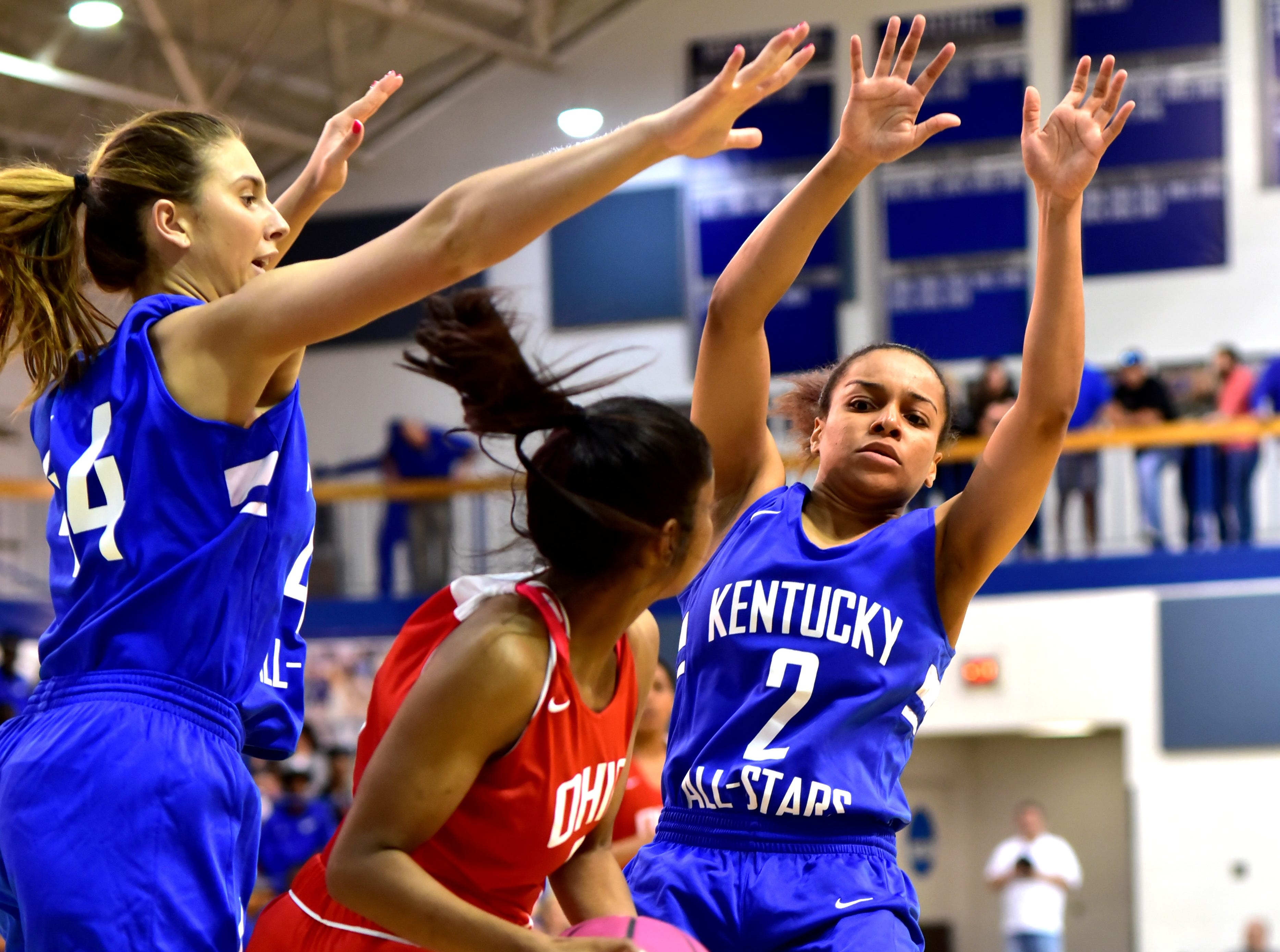 Ivy Turner (2) of Danville and Hayley Harrison of George Rogers Clark of the Kentucky girls team tie up Lakota West's Bryana Henderson in first quarter action at the 28th Annual Ohio-Kentucky All Star Games played at Thomas More University, April 13, 2019