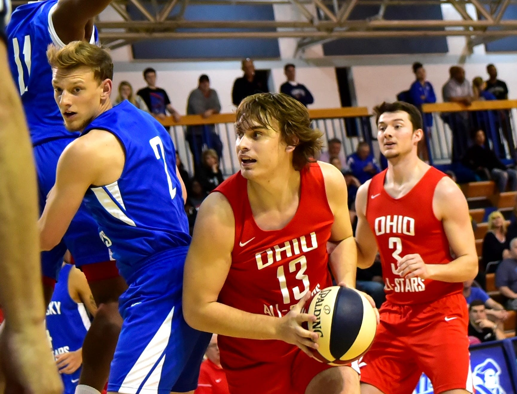 Mason Darby (13) of Oak Hill looks to put back an offensive rebound for an Ohio boys team score at the 28th Annual Ohio-Kentucky All Star Games played at Thomas More University, April 13, 2019