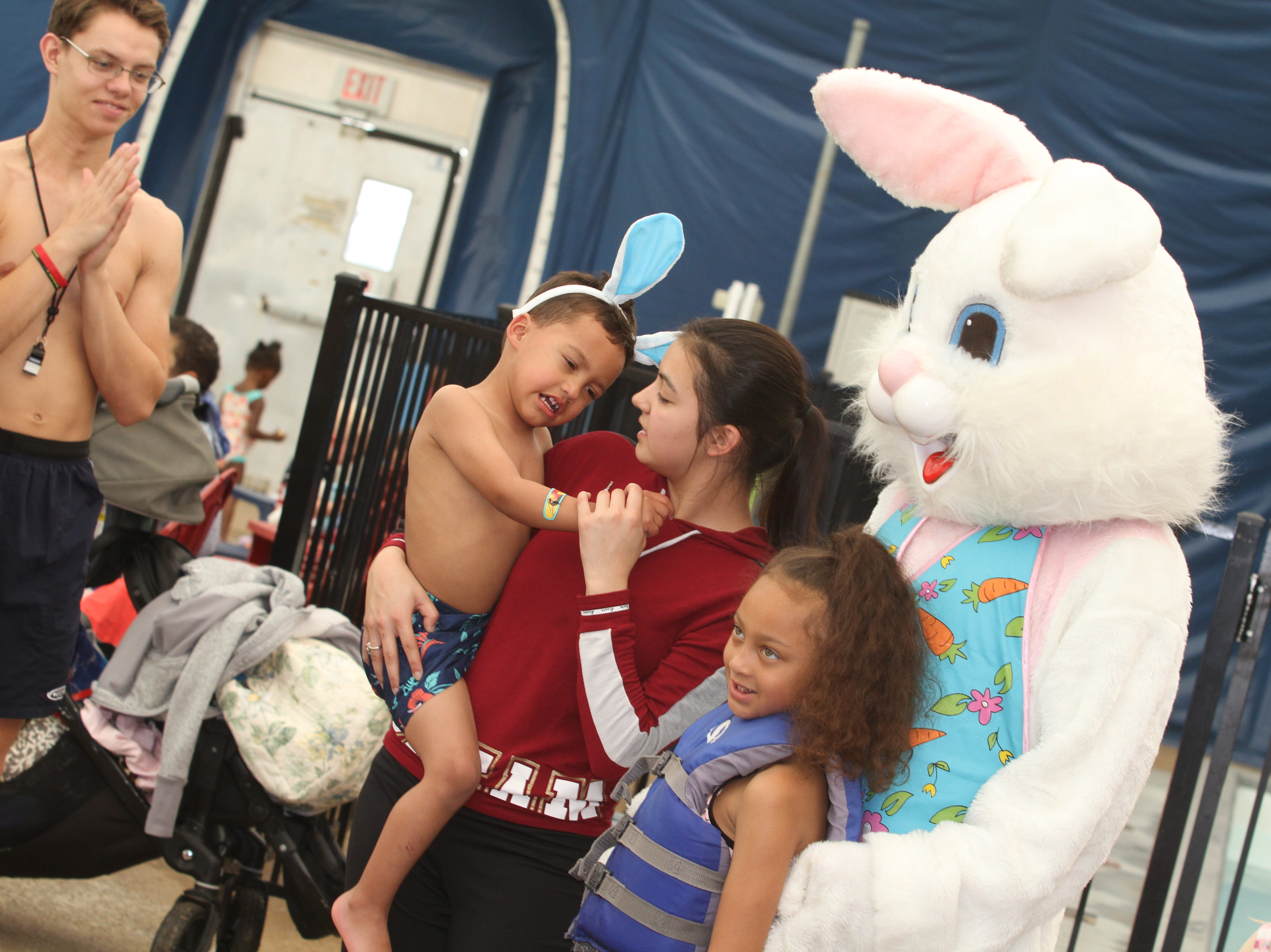 The Easter Bunny  makes friends at the Wettest Egg Hunt at the New Providence Aquatic Center on Saturday, April 13, 2019.