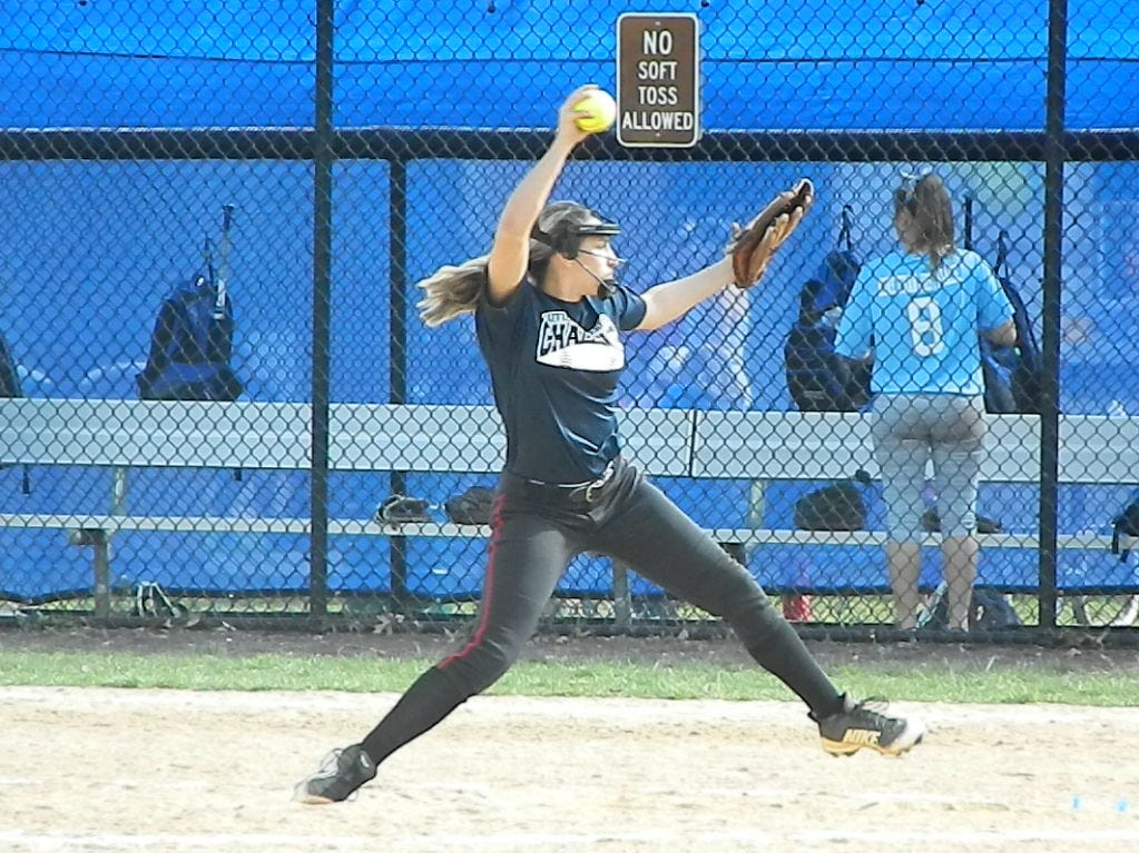 Woodbridge's Gia Dominguez pitches against North Brunswick during the Autism Awareness Challenge on Saturday, April 13, 2019 at North Brunswick Community Park.