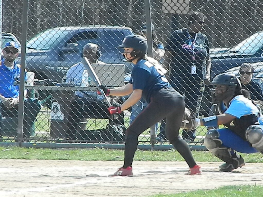 Woodbridge's Emily Christie bats against North Brunswick during the Autism Awareness Challenge on Saturday, April 13, 2019 at North Brunswick Community Park.