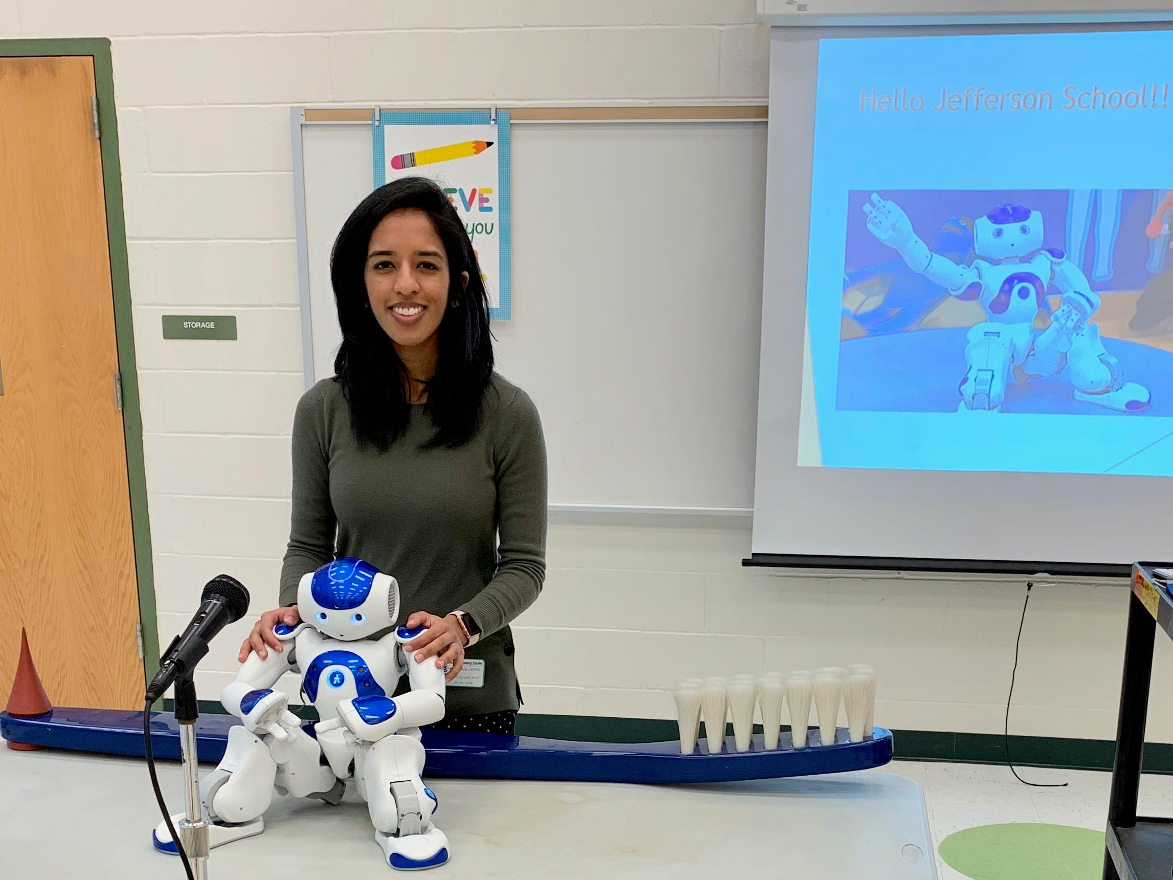 On staff for four years at Olin Dental Group, Medithe robot, here with Dr. Neha Golwala, isprogrammed in order to act asa companion along side children in a dental operatory. Medi is able to speak to children at their level and decrease their concerns, anxietyand fears when they come to the dentist.