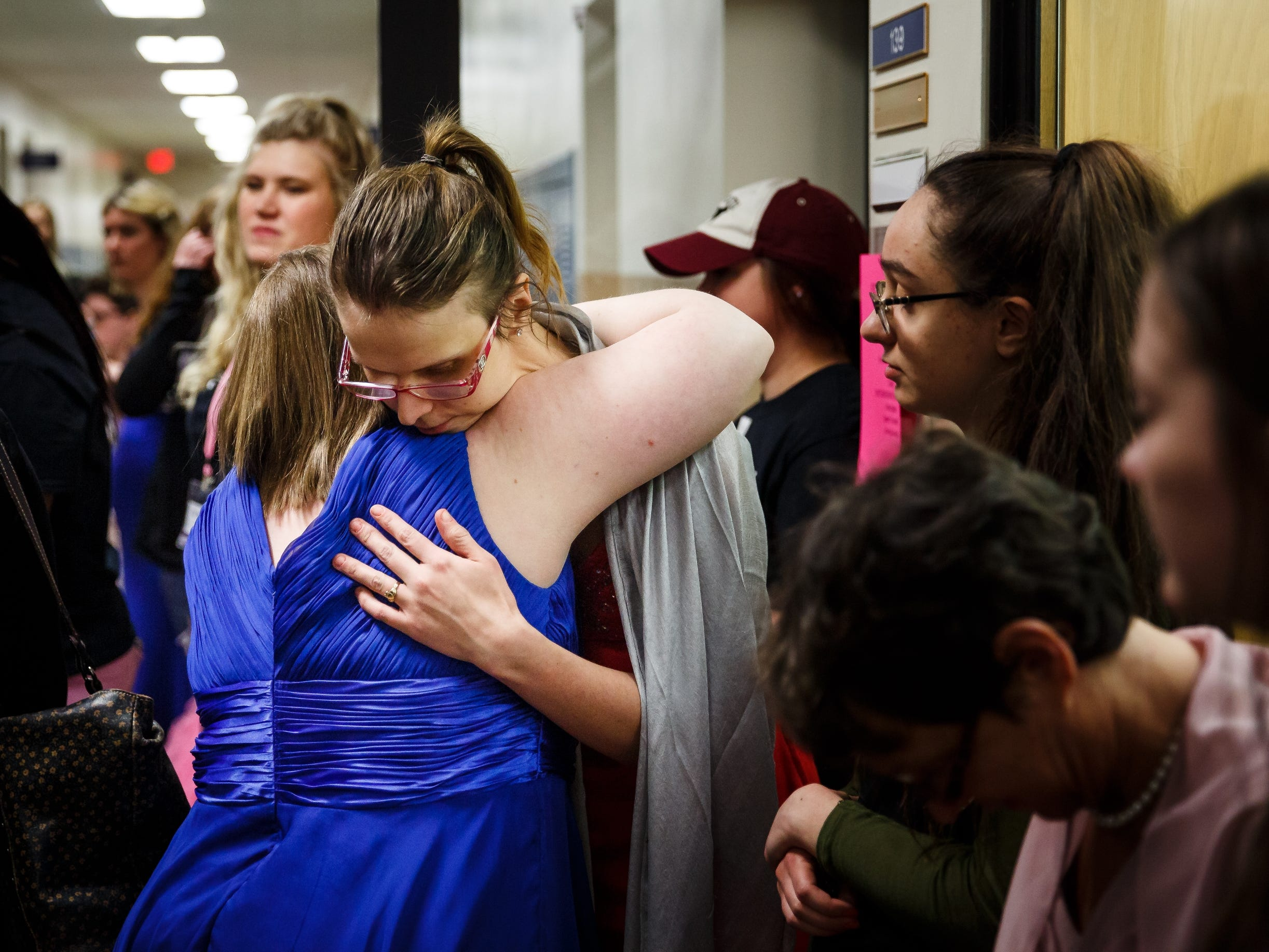 Amy Lukenbill, 33 of Altoona, right, gets a hug from Annie Woiwood, 25 of Des Moine, left, as they wait for results in the 2019 Miss Amazing pageant at Franklin Jr. High School on Saturday, April 13, 2019, in Des Moines.