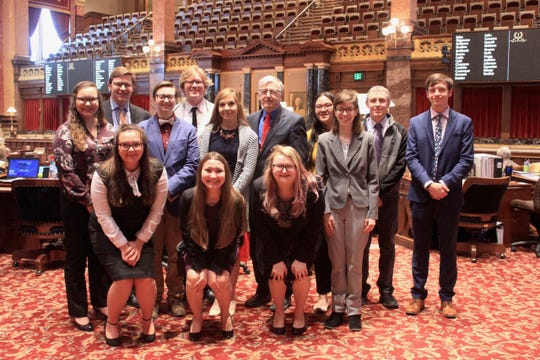 Members of the Simpson College national champion debate team met with state Sen. Julian Garrett in the Iowa Senate chamber. They were recognized in the Senate for their accomplishment on April 9. Simpson has won the national championship three of the last four years.