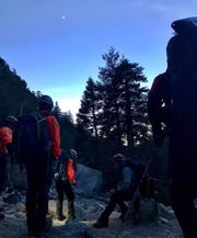 West Valley (California) Search and Rescue crew members shown during a search for Iowan Eric DeSplinter and Gabrielle Wallace who were missing for five days before being rescued in the San Gabriel Mountains on Wednesday.