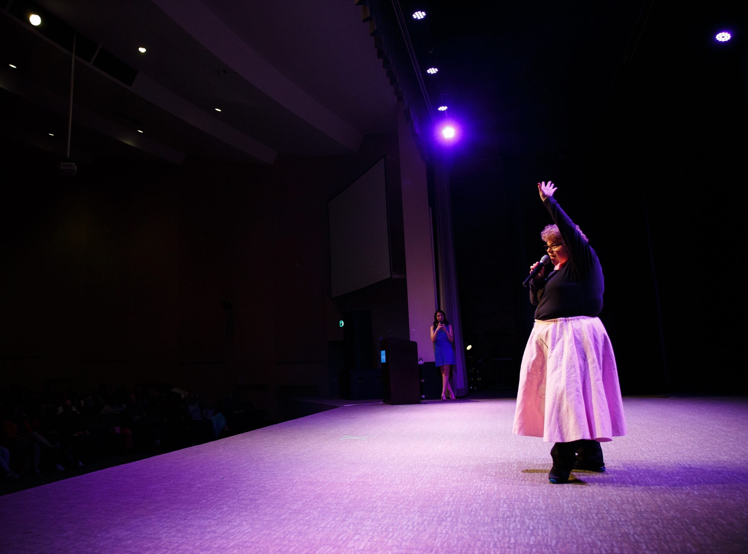 """Katie Brown competes in the talent portion of the 2019 Miss Amazing pageant by singing """"Grease"""" at Franklin Jr. High School on Saturday, April 13, 2019, in Des Moines. The event started in 2013 and gives women with disabilities the opportunity to learn new skills and build confidence while adding in some friendly competition."""