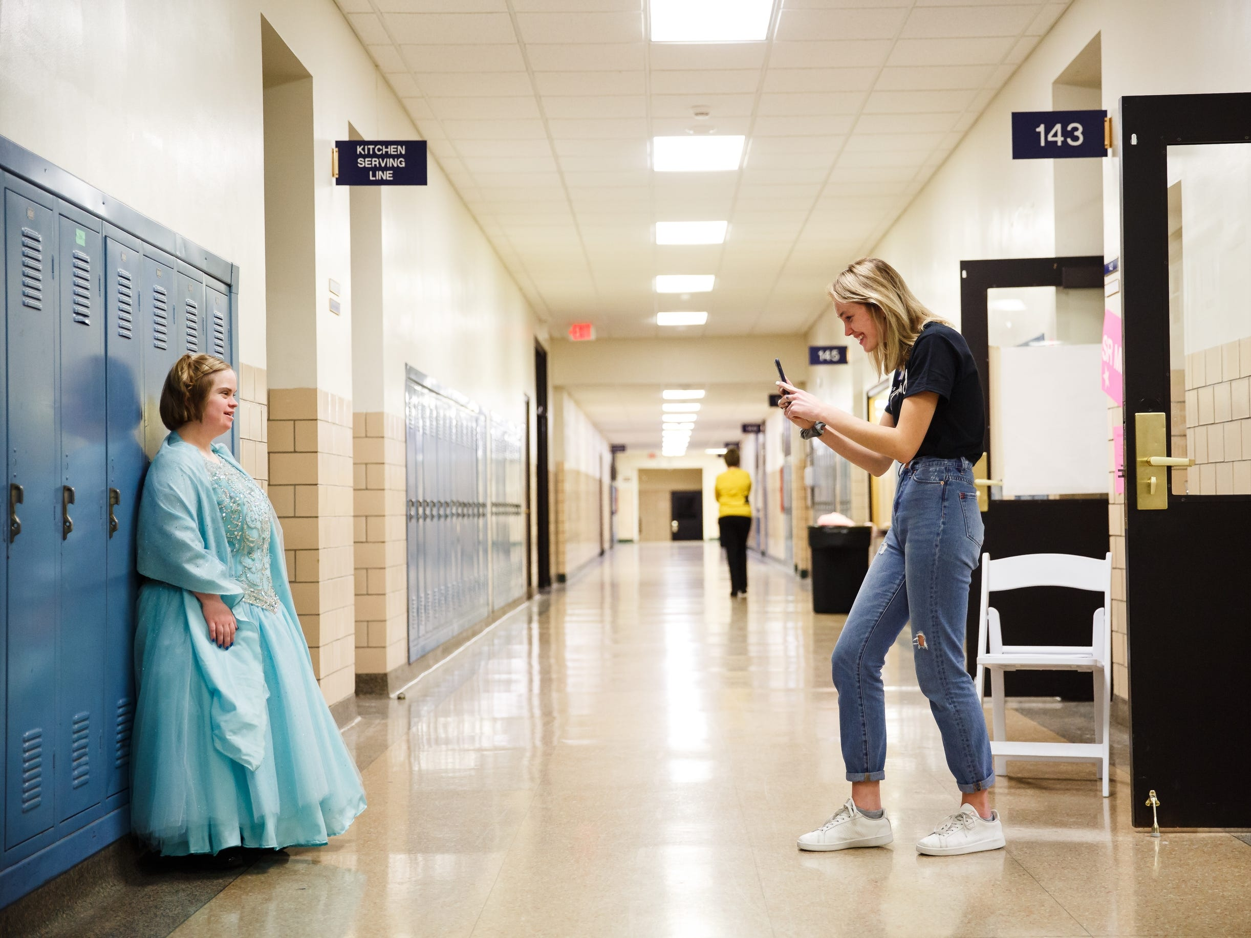 Cait Doty, 23 of Des Moines takes a photo of her buddy Jenna Simmons, 28 of Spirit Lake during the 2019 Miss Amazing pageant at Franklin Jr. High School on Saturday, April 13, 2019, in Des Moines.