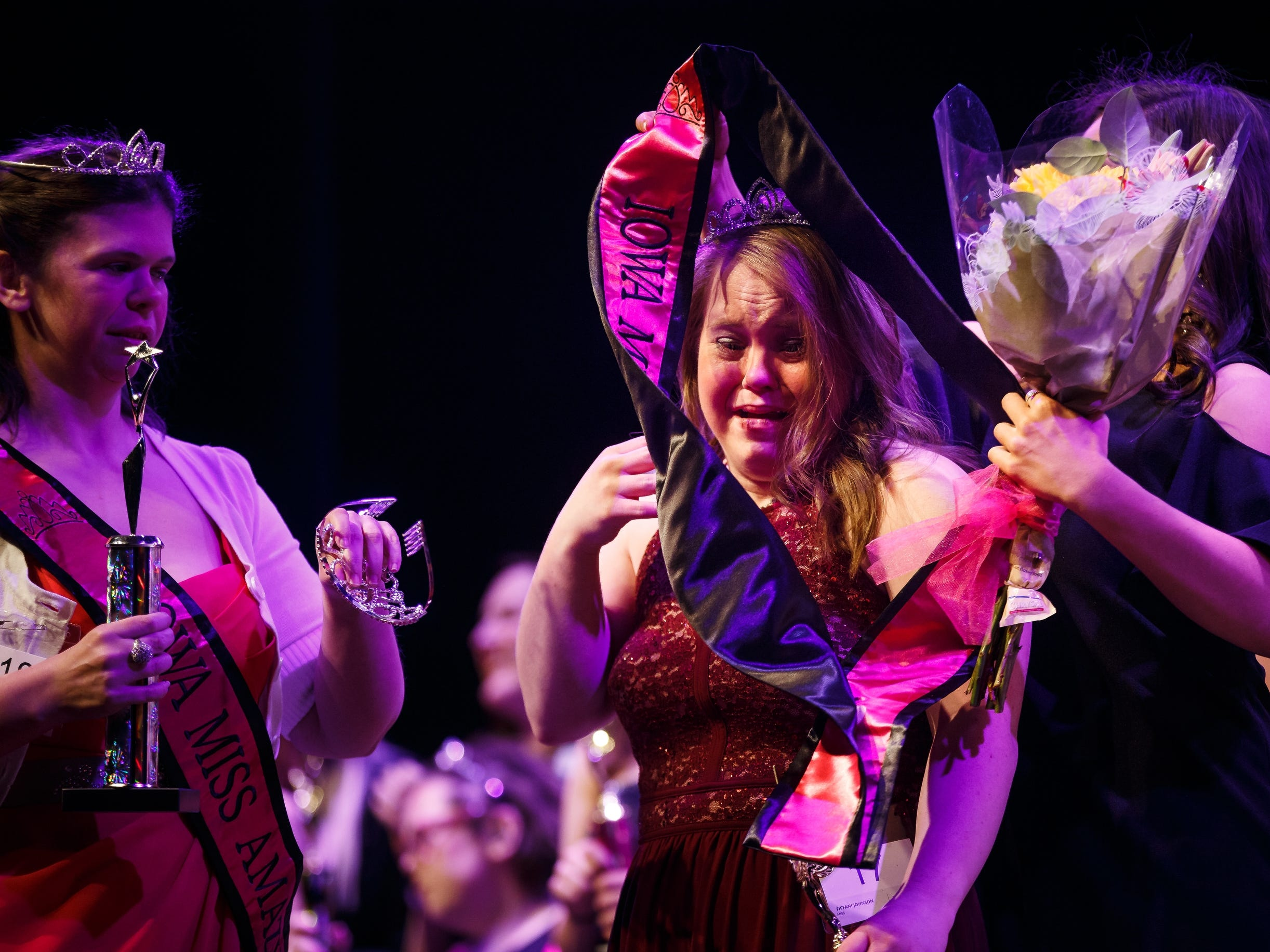 Tiffani Johnson tears up as she is announced as the 2019 Miss Amazing during the 2019 Miss Amazing pageant at Franklin Jr. High School on Saturday, April 13, 2019, in Des Moines. The event started in 2013 and gives women with disabilities the opportunity to learn new skills and build confidence while adding in some friendly competition.