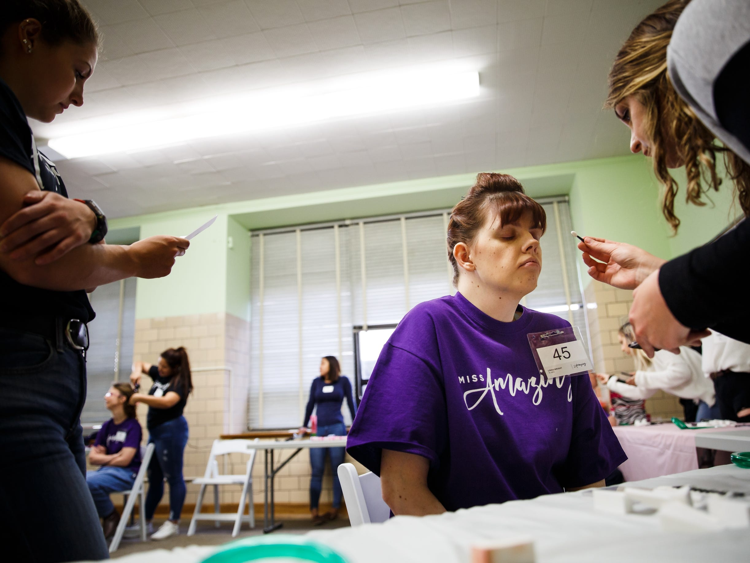 Linda Wright has her makeup done before the 2019 Miss Amazing pageant at Franklin Jr. High School on Saturday, April 13, 2019, in Des Moines.