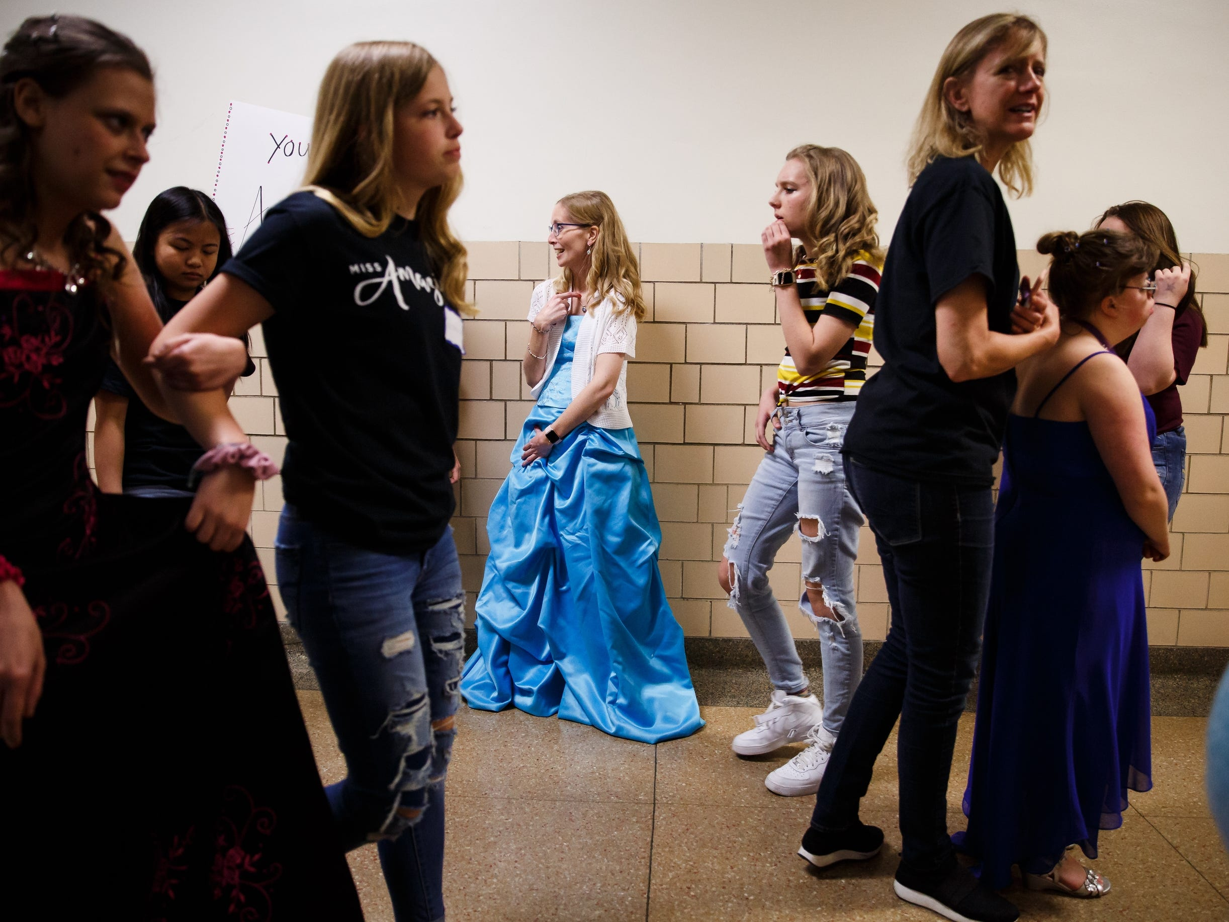 Carla Lahart, 34 of Ankeny waits in the hallway for winners to be announced during the 2019 Miss Amazing pageant at Franklin Jr. High School on Saturday, April 13, 2019, in Des Moines.