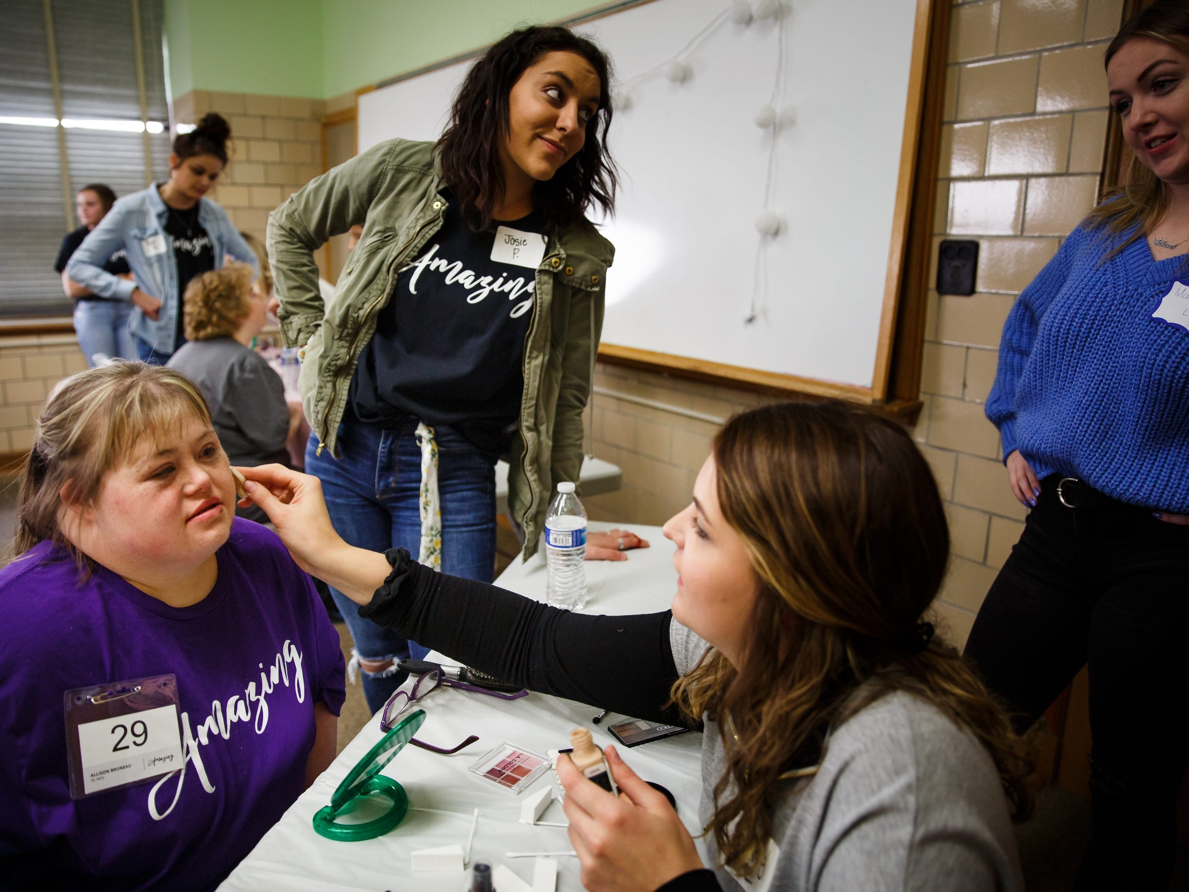 Allison Bruneau has her makeup done before the 2019 Miss Amazing pageant at Franklin Jr. High School on Saturday, April 13, 2019, in Des Moines. The event started in 2013 and gives women with disabilities the opportunity to learn new skills and build confidence while adding in some friendly competition.