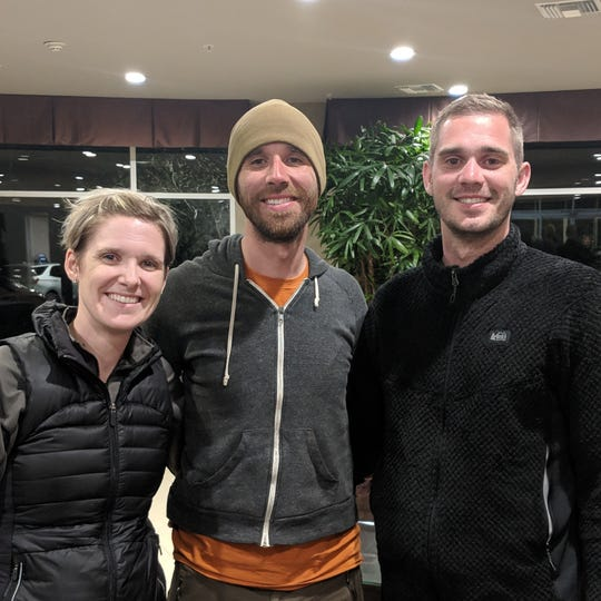 Eric DeSplinter, a 33-year-old Iowa native, stands with his brother, Tim (right), and sister Nikki Deardorff after going missing for five days in the San Gabriel Mountains in California.
