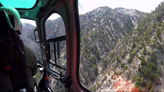 The view from a West Valley (California) Search and Rescue helicopter last week as crew members looked for Iowan Eric DeSplinter and Gabrielle Wallace who were missing in the San Gabriel Mountains for five days before being rescued Wednesday.