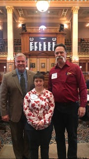Steve and Carly Steveson from Indianola visited state Rep. Scott Ourth at the Capitol to talk about how they have been failed by privatized Medicaid.