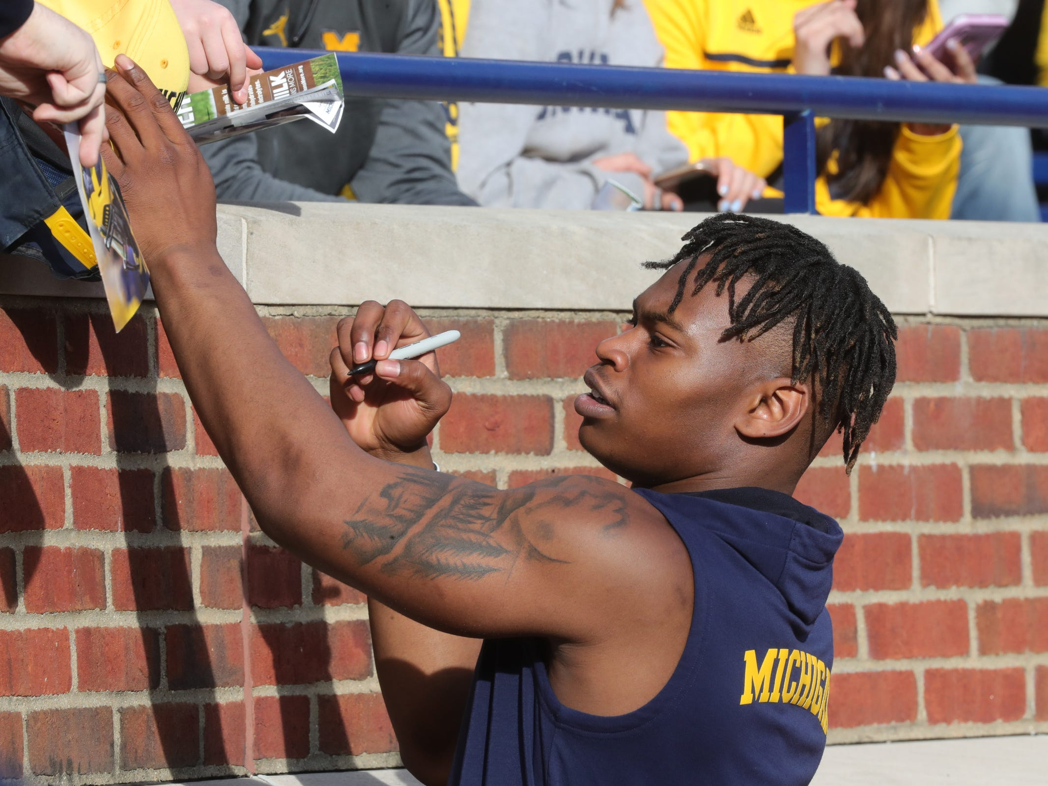 Michigan running back Christian Turner signs autographs during the spring game Saturday, April 13, 2019 at Michigan Stadium in Ann Arbor.