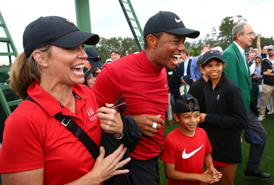 Apr 14, 2019; Augusta, GA, USA; Tiger Woods celebrates with daughter Sam and son Charlie after winning The Masters golf tournament at Augusta National Golf Club, April 14, 2019.