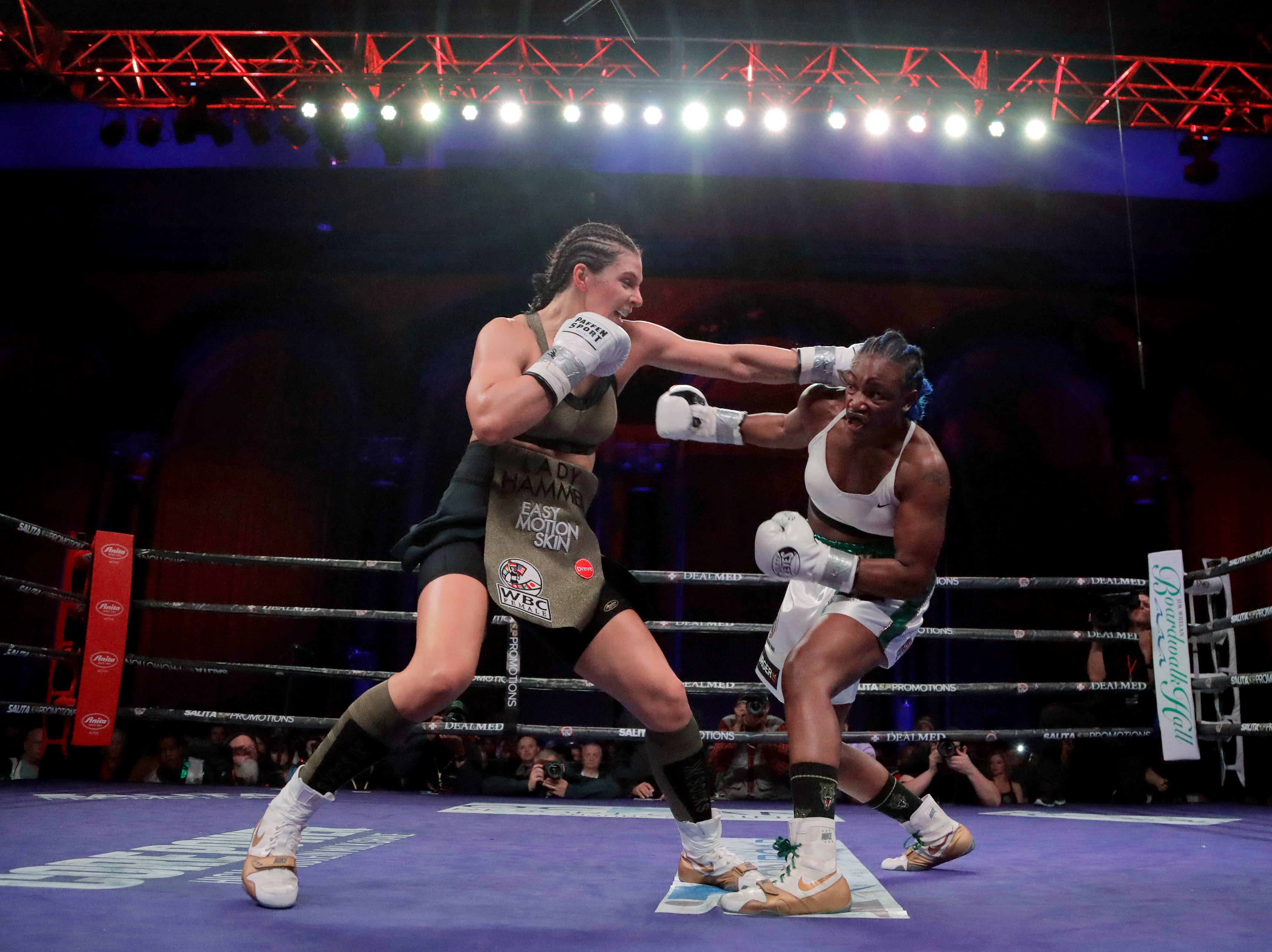 Christina Hammer, left, and Claressa Shields fight during the third round of a women's world middleweight championship boxing bout Saturday, April 13, 2019, in Atlantic City, N.J.