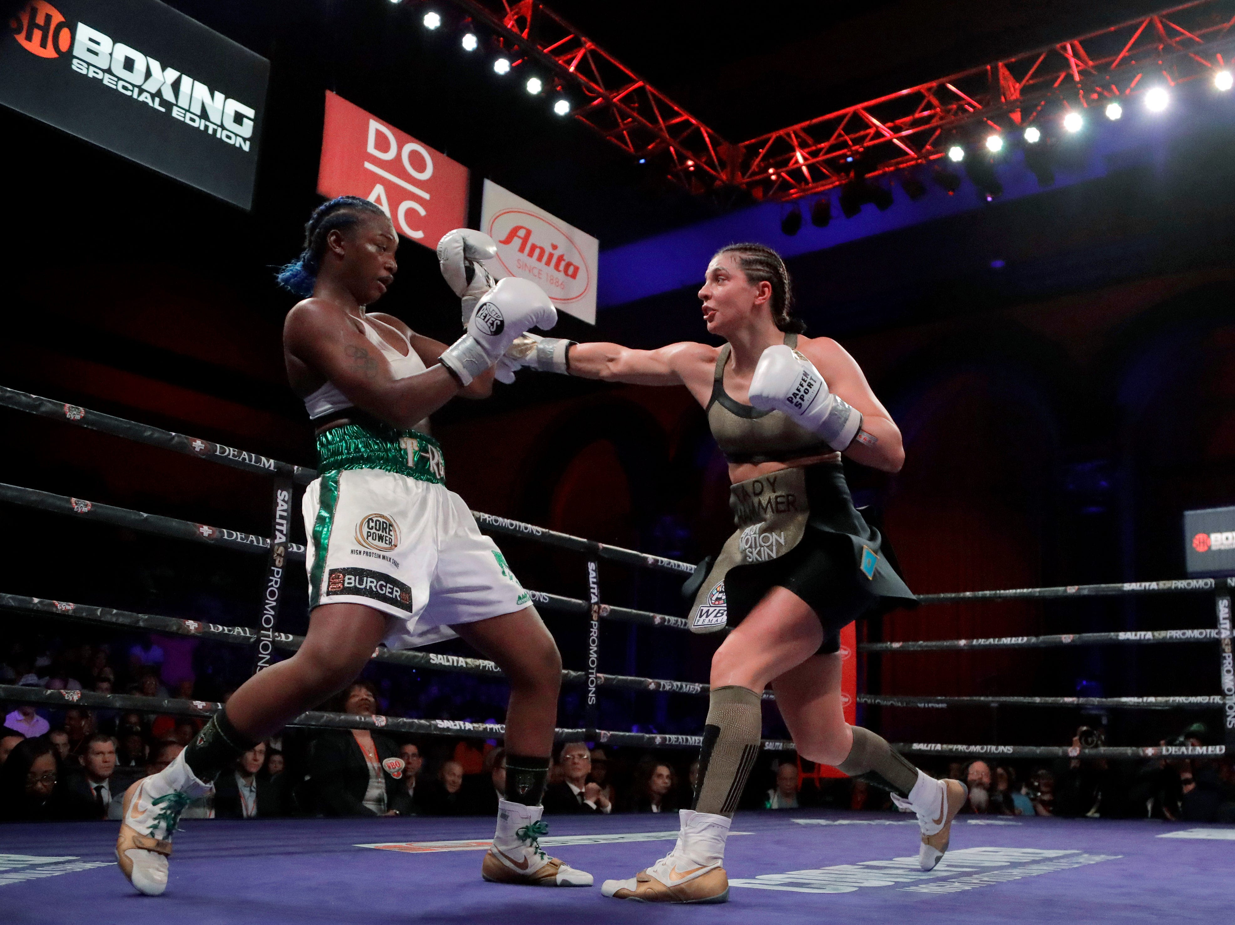 Christina Hammer, right, throws a right at Claressa Shields during the seventh round of the women's middleweight championship boxing bout Saturday, April 13, 2019, in Atlantic City, N.J. Shields won by unanimous decision.