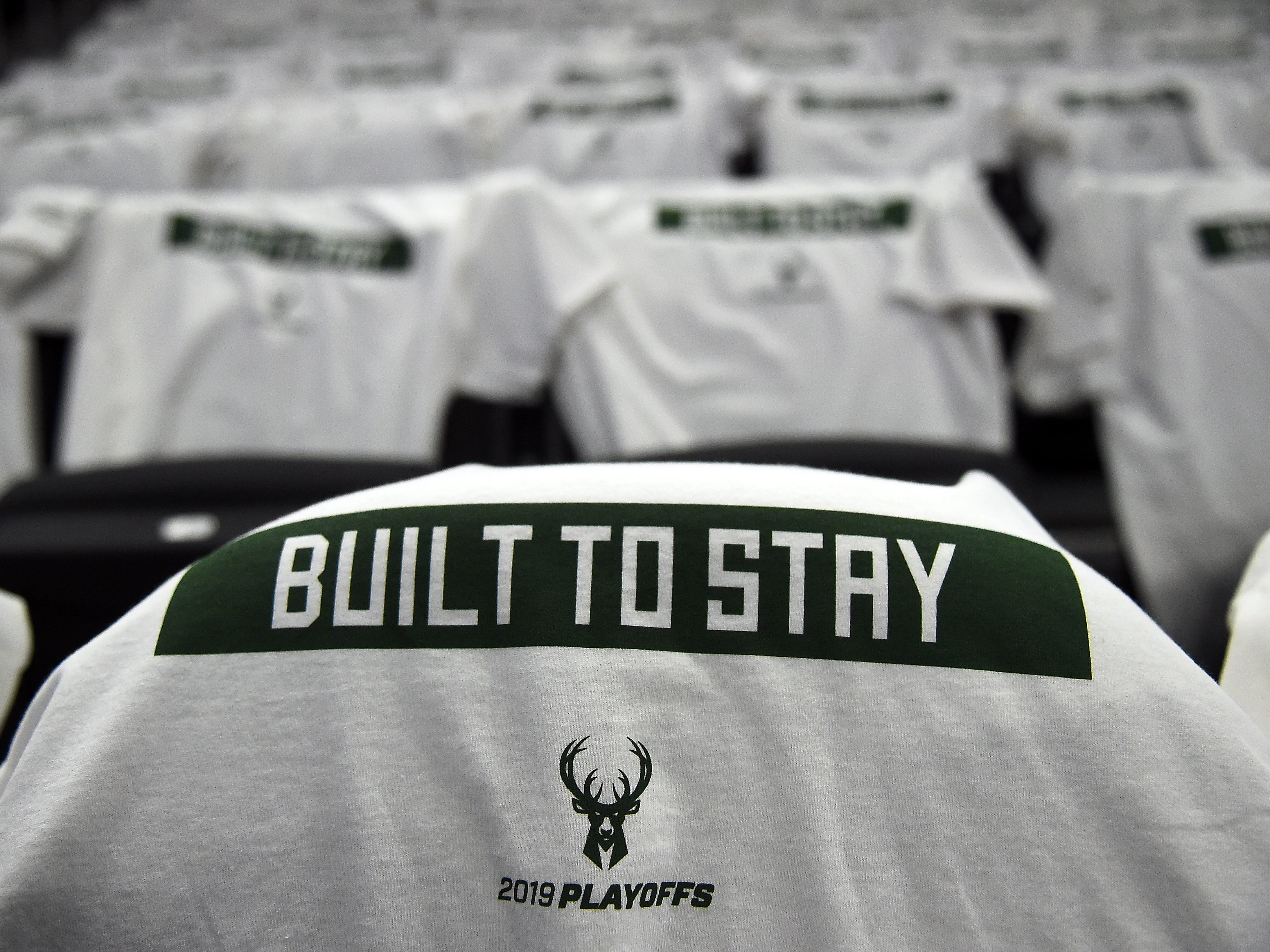A detailed view of T-shirts on chairs prior to Game 1 of the playoffs between the Milwaukee Bucks and the Detroit Pistons at Fiserv Forum on April 14, 2019 in Milwaukee, Wisc.