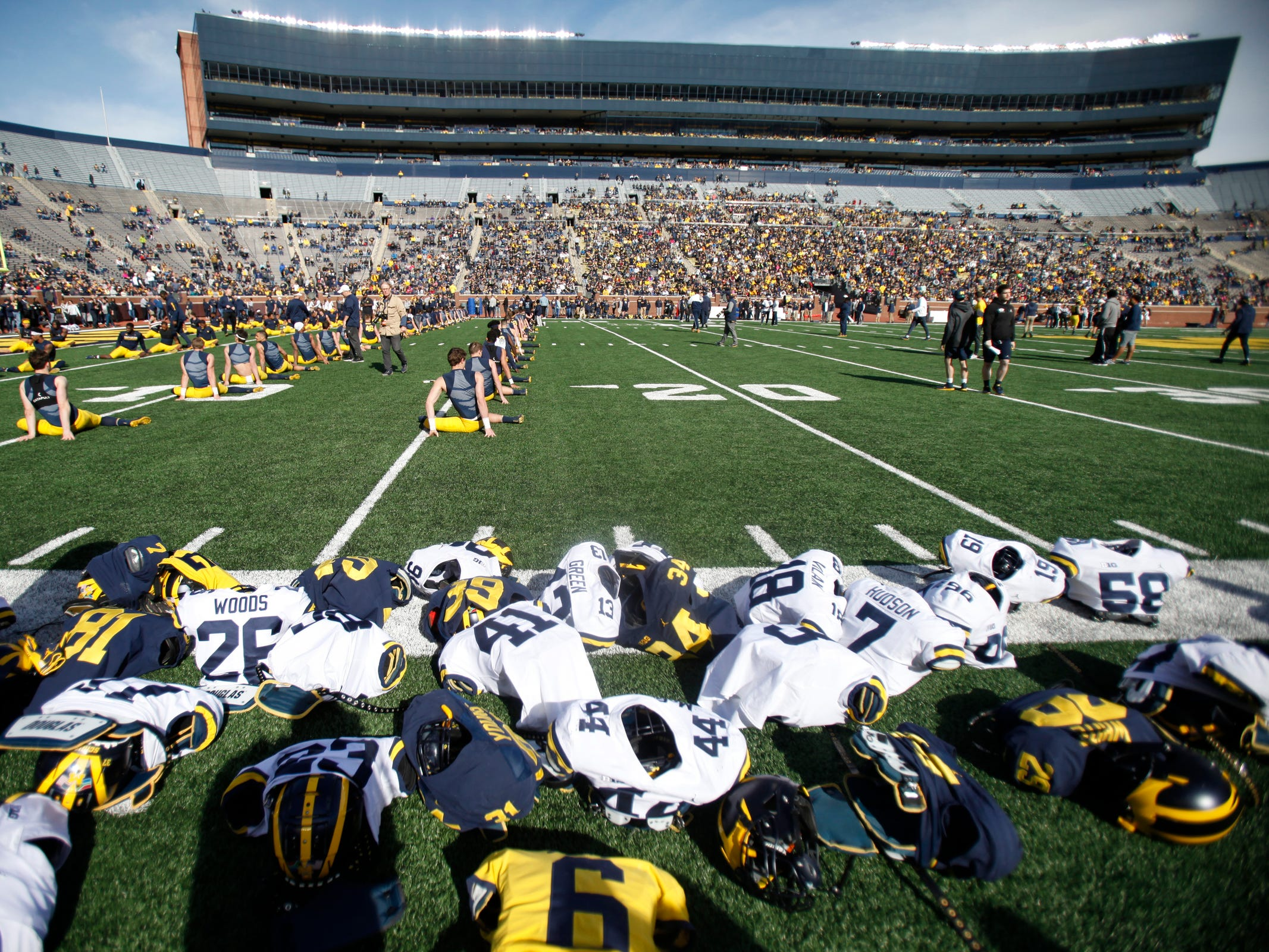 Michigan players warm up before the spring game Saturday, April 13, 2019 at Michigan Stadium in Ann Arbor.