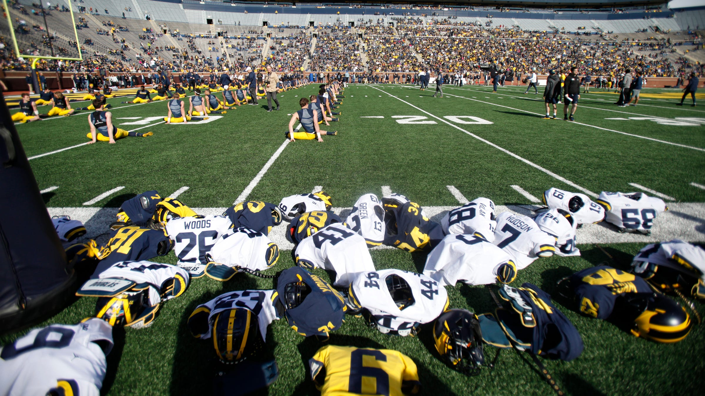 Michigan players warm up before the spring game...