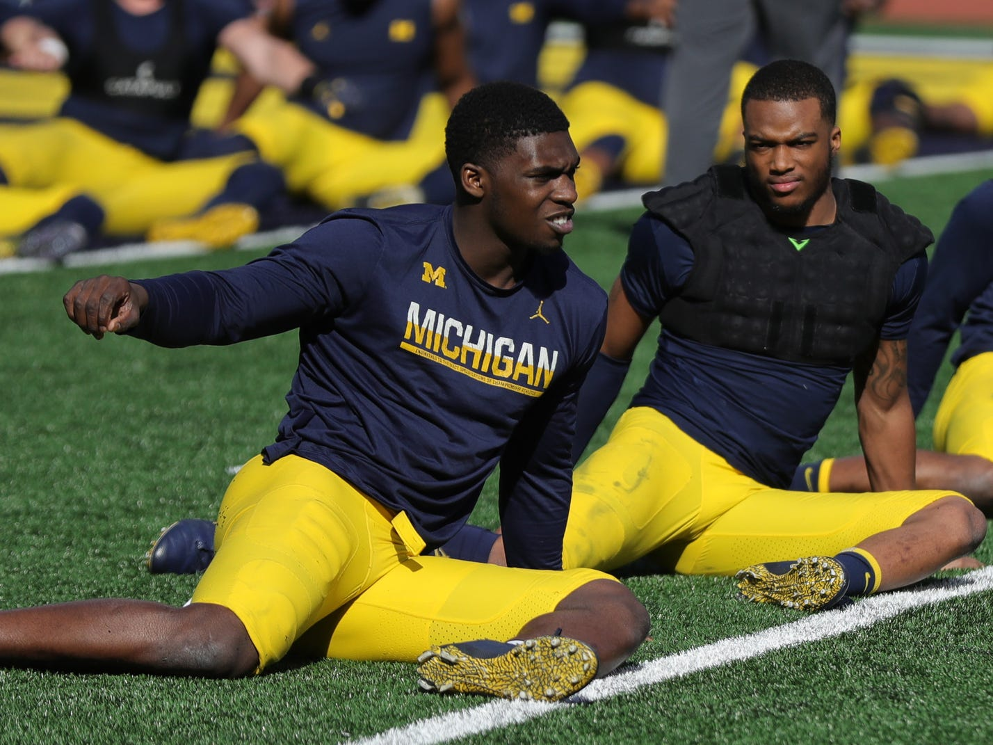 Michigan players stretch before the spring game Saturday, April 13, 2019 at Michigan Stadium in Ann Arbor.