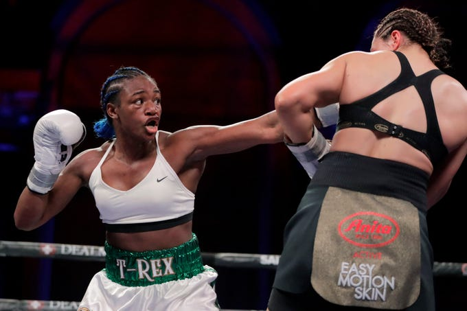 Claressa Shields, left, throws a left at Christina Hammer during the second round of the women's middleweight championship boxing bout Saturday, April 13, 2019, in Atlantic City, N.J. Shields won by unanimous decision.