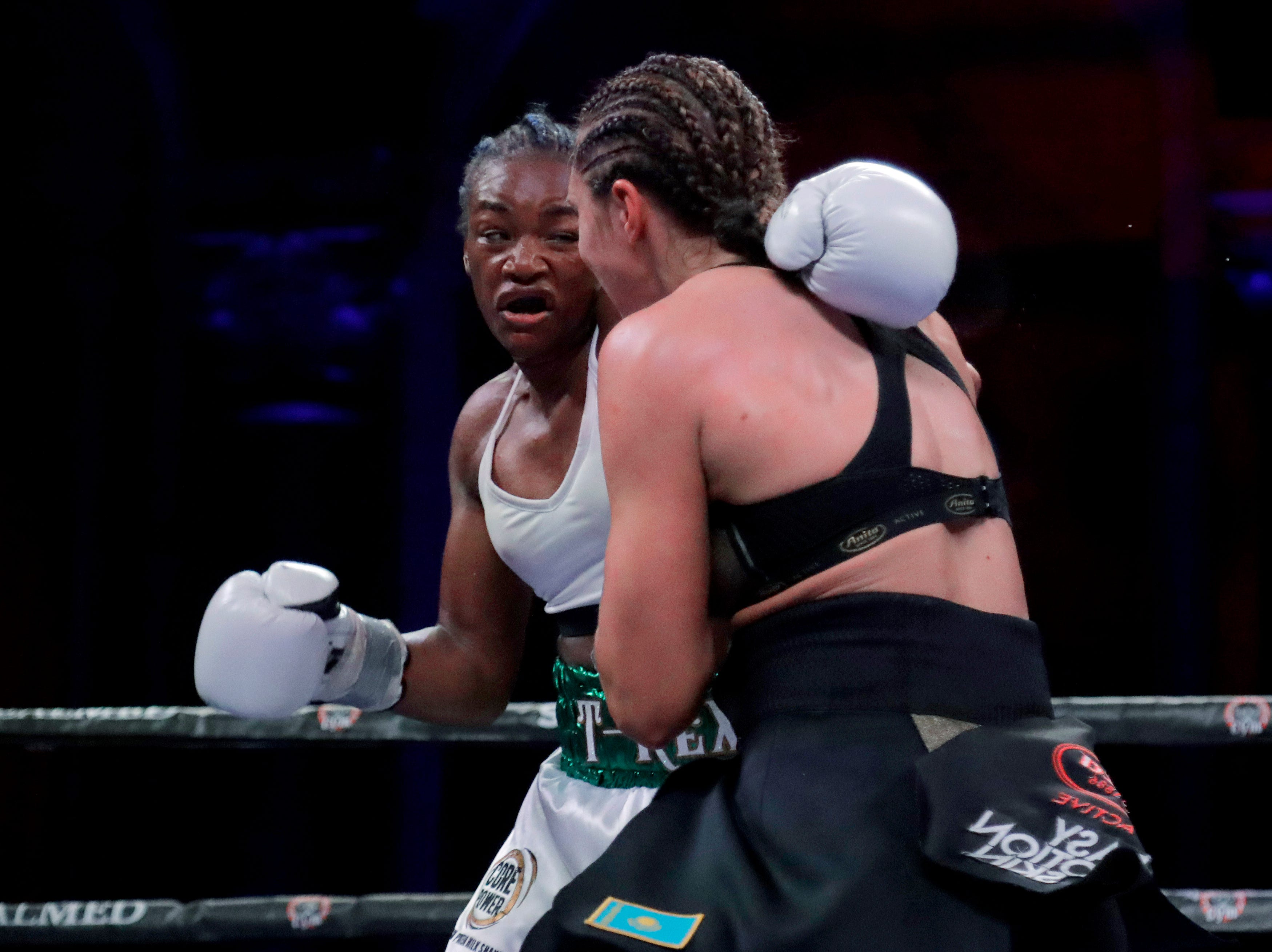 Claressa Shields, left, and Christina Hamner fight during the sixth round of a women's world middleweight championship boxing bout Saturday, April 13, 2019, in Atlantic City, N.J. Shields won by unanimous decision.