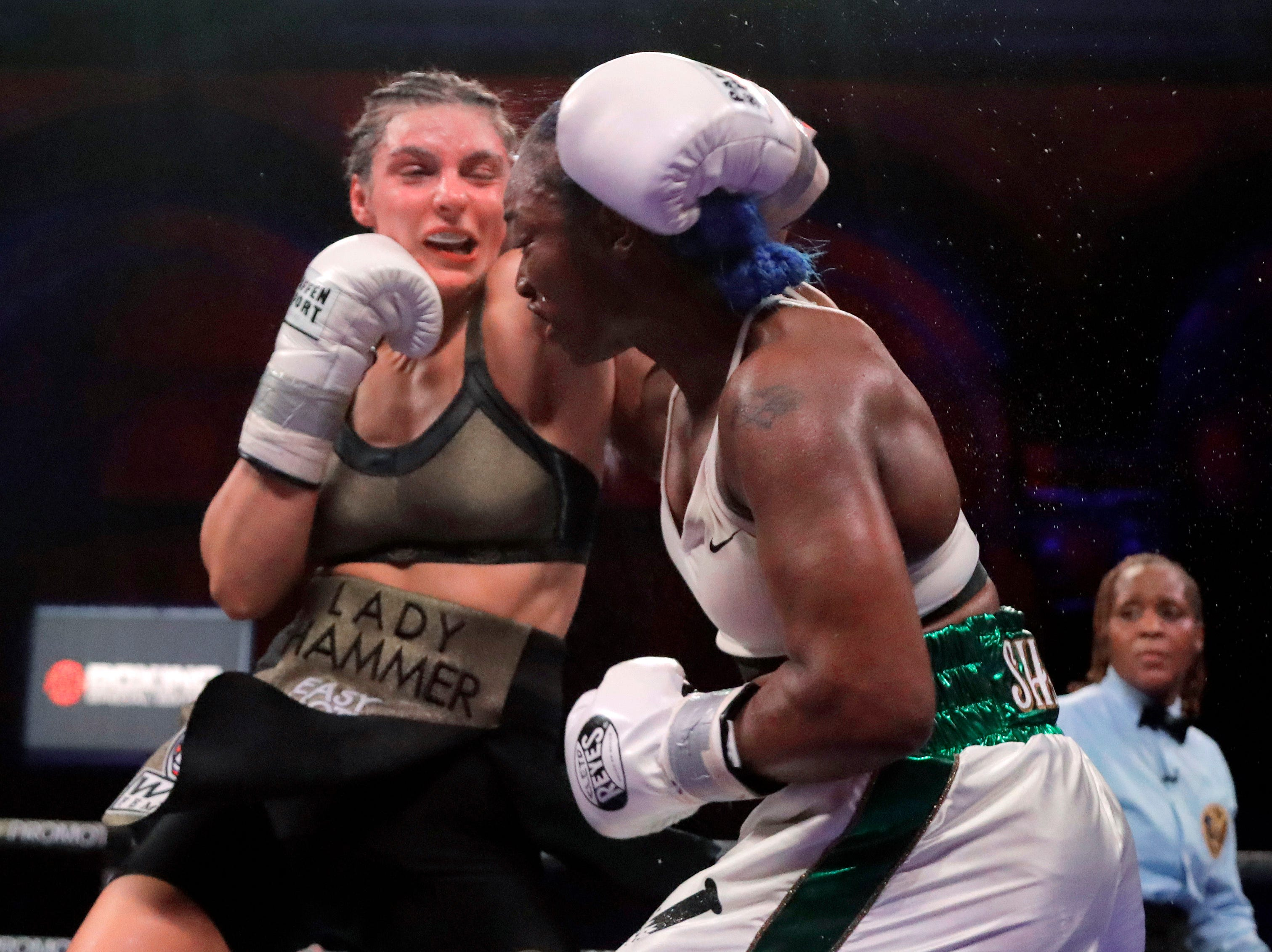 Christina Hammer, left, and Claressa Shields fight during the 10th round of a women's middleweight championship boxing bout, Saturday, April 13, 2019, in Atlantic City, N.J. Shields won by unanimous decision.