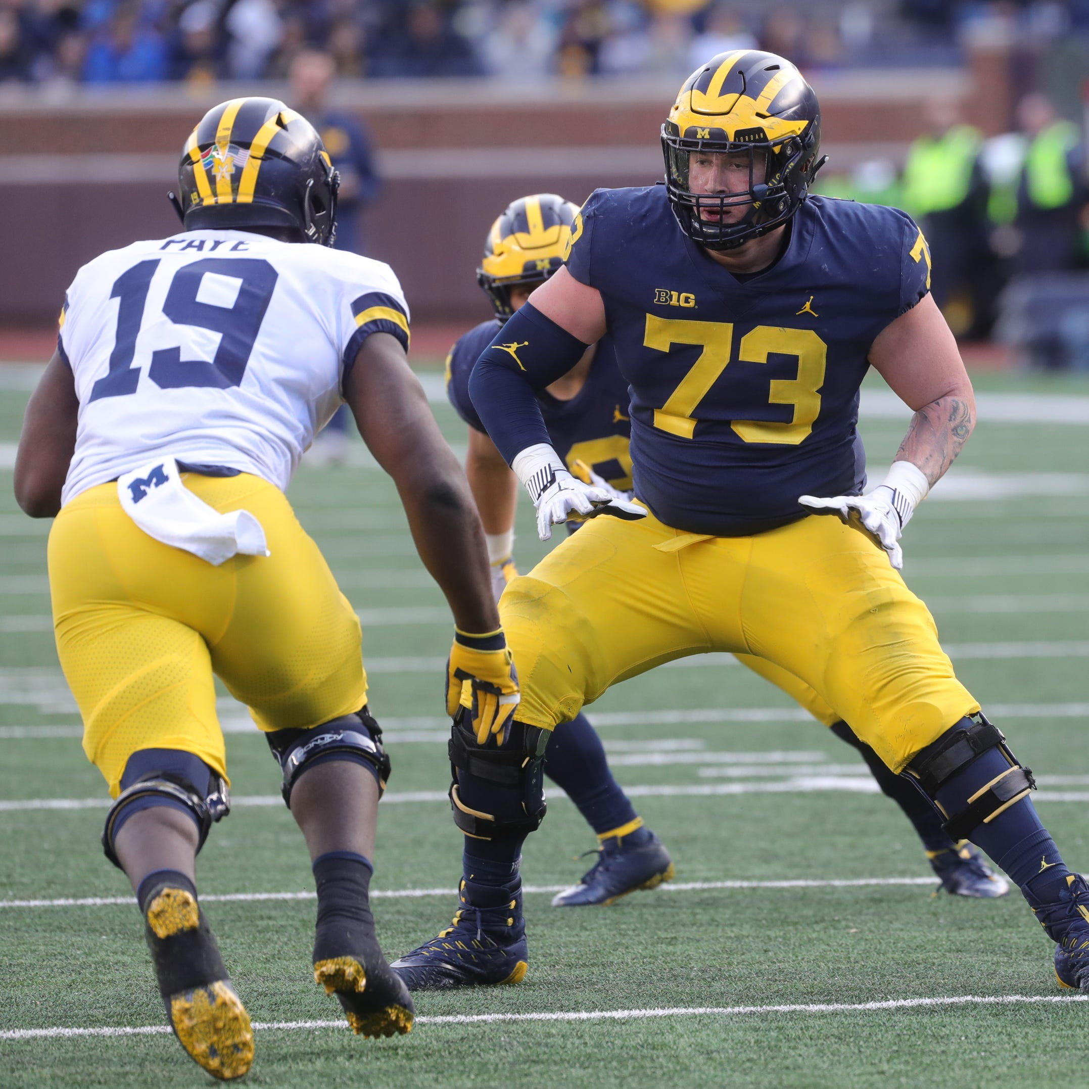 Michigan's Jalen Mayfield in thick of right-tackle competition