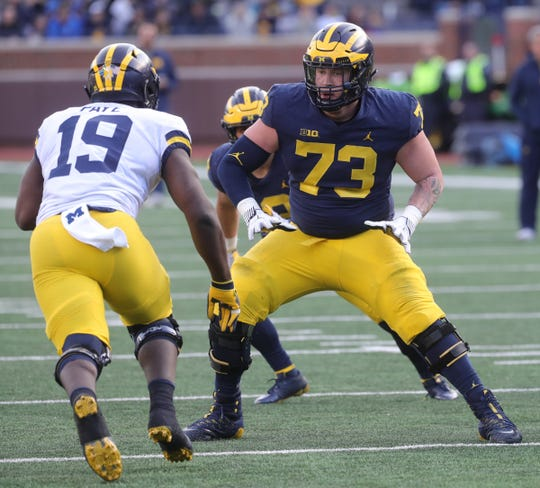 Michigan offensive lineman Jalen Mayfield blocks defensive end Kwity Paye during the spring game Saturday, April 13, 2019 at Michigan Stadium in Ann Arbor.