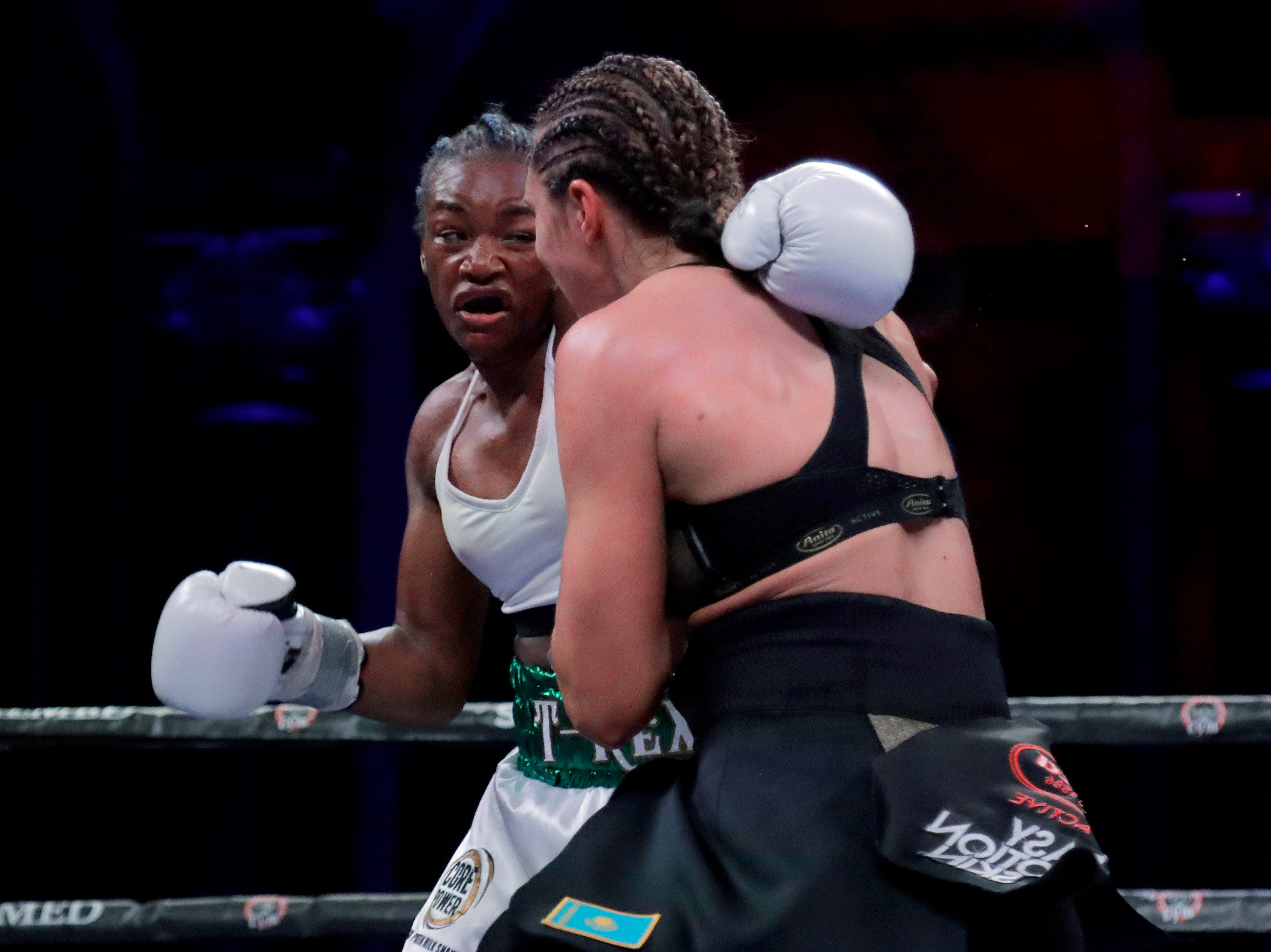 Claressa Shields, left, and Christina Hammer fight during the sixth round of a women's world middleweight championship boxing bout Saturday, April 13, 2019, in Atlantic City, N.J. Shields won by unanimous decision.