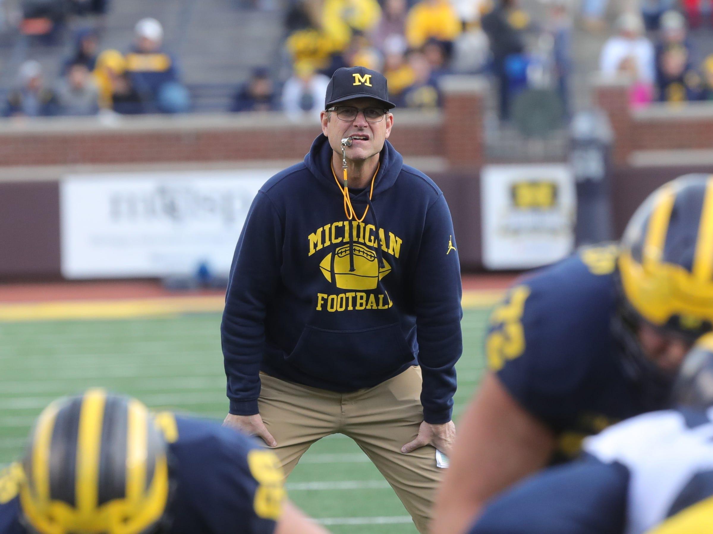 Michigan head coach Jim Harbaugh watches the spring game Saturday, April 13, 2019 at Michigan Stadium in Ann Arbor.