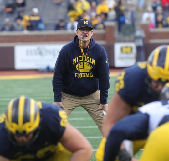 Michigan head coach Jim Harbaugh watches the spring game Saturday, April 13, 2019 at Michigan Stadium in Ann Arbor.