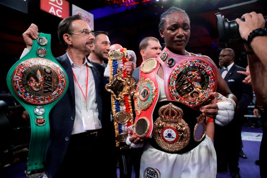 Claressa Shields holds her belts after defeating Christina Hammer by unanimous decision in the women's world middleweight championship boxing bout Saturday, April 13, 2019, in Atlantic City, N.J.