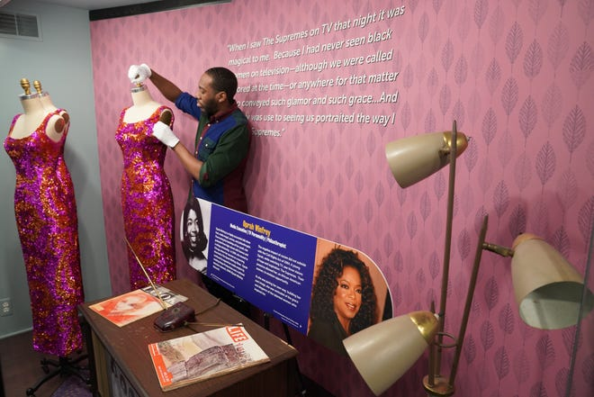 """David Ellis, collection assistant at the Motown Museum, prepares a mannequin featuring an original gown worn by the Supremes in the mid-1960s, on Sunday, April 14, 2019. It's part of the museum's new exhibit, """"Reflections: My Motown Story."""""""