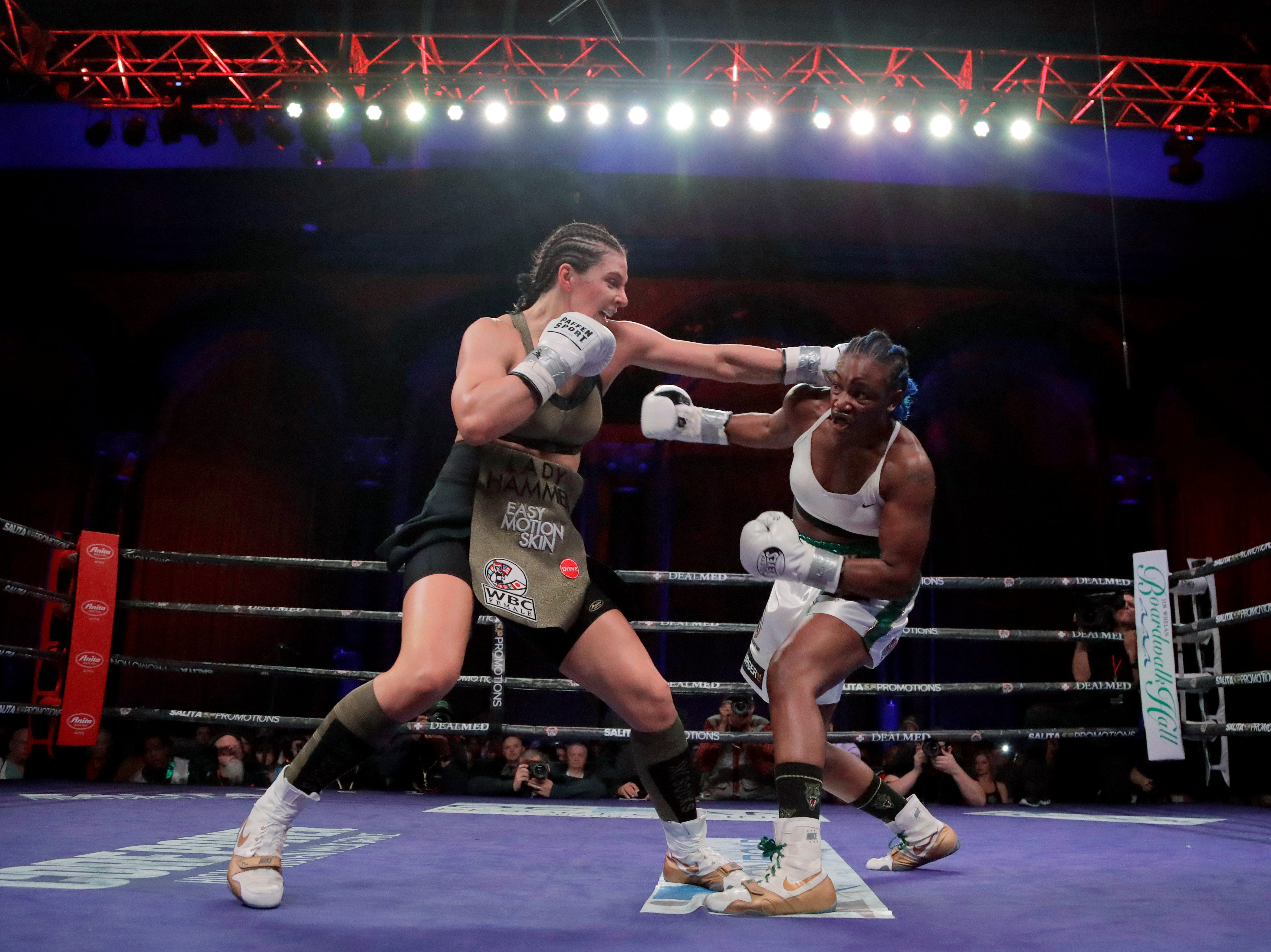 Christina Hamner, left, and Claressa Shields fight during the third round of a women's world middleweight championship boxing bout Saturday, April 13, 2019, in Atlantic City, N.J.
