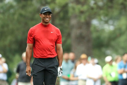 Tiger Woods of the United States smiles on the ninth hole during the final round of the Masters at Augusta National Golf Club on April 14, 2019 in Augusta, Georgia.