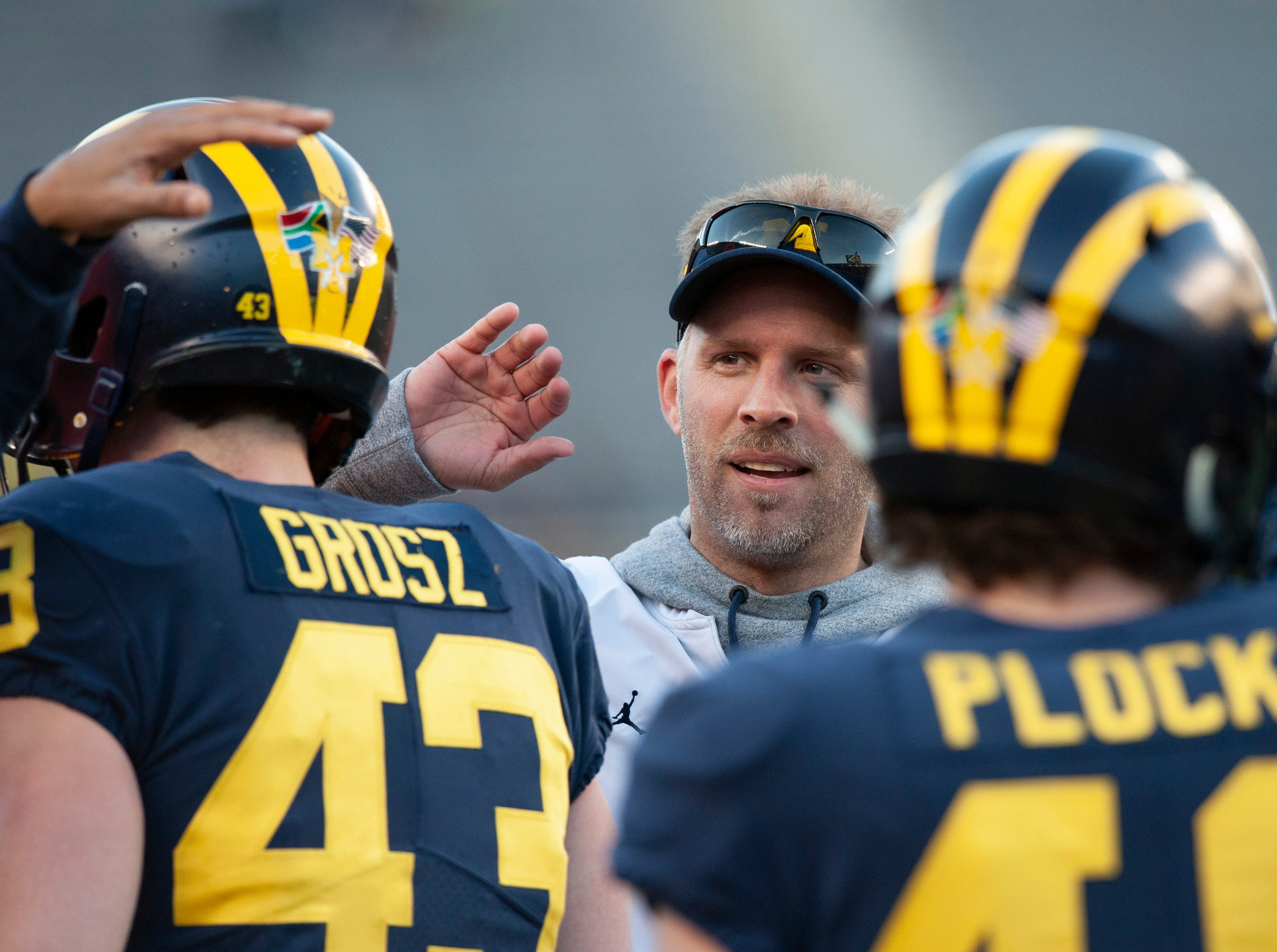 Michigan's new quarterbacks coach Ben McDaniels reacts to a touchdown reception during the scrimmage.