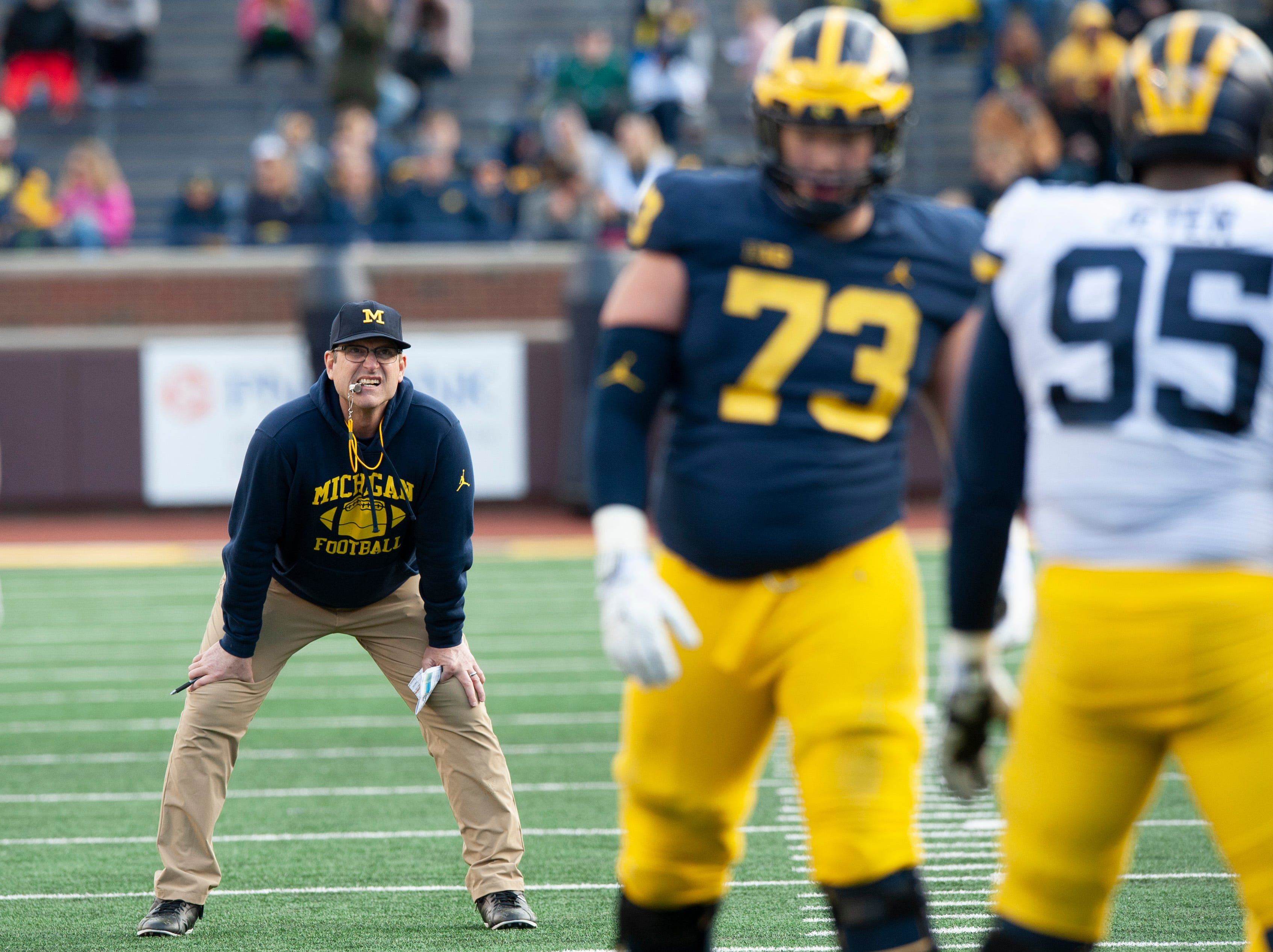 Michigan head coach Jim Harbaugh watches closely during the scrimmage.