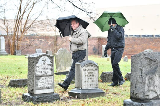 From left, Mike Skinner, 62, and John Ambrogio, 82, both of St. Clair Shores, look around at the Beth Olem Cemetery at the GM Detroit