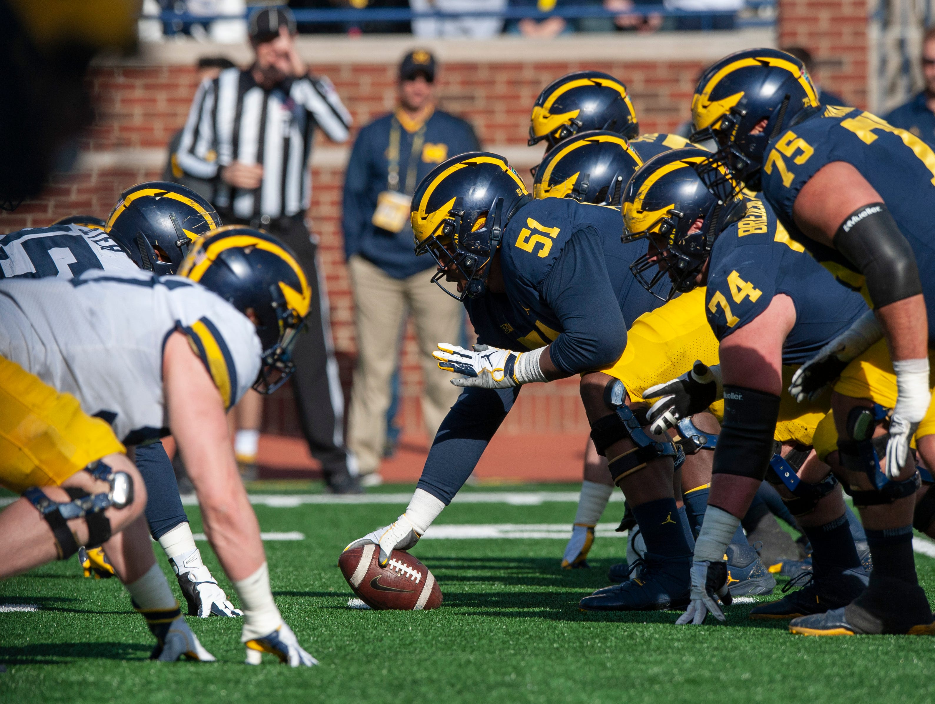 Michigan center Cesar Ruiz (51) gets ready to snap the football as the Michigan offense lines up against the Michigan defense during the 2019 Spring Game at the Big House.