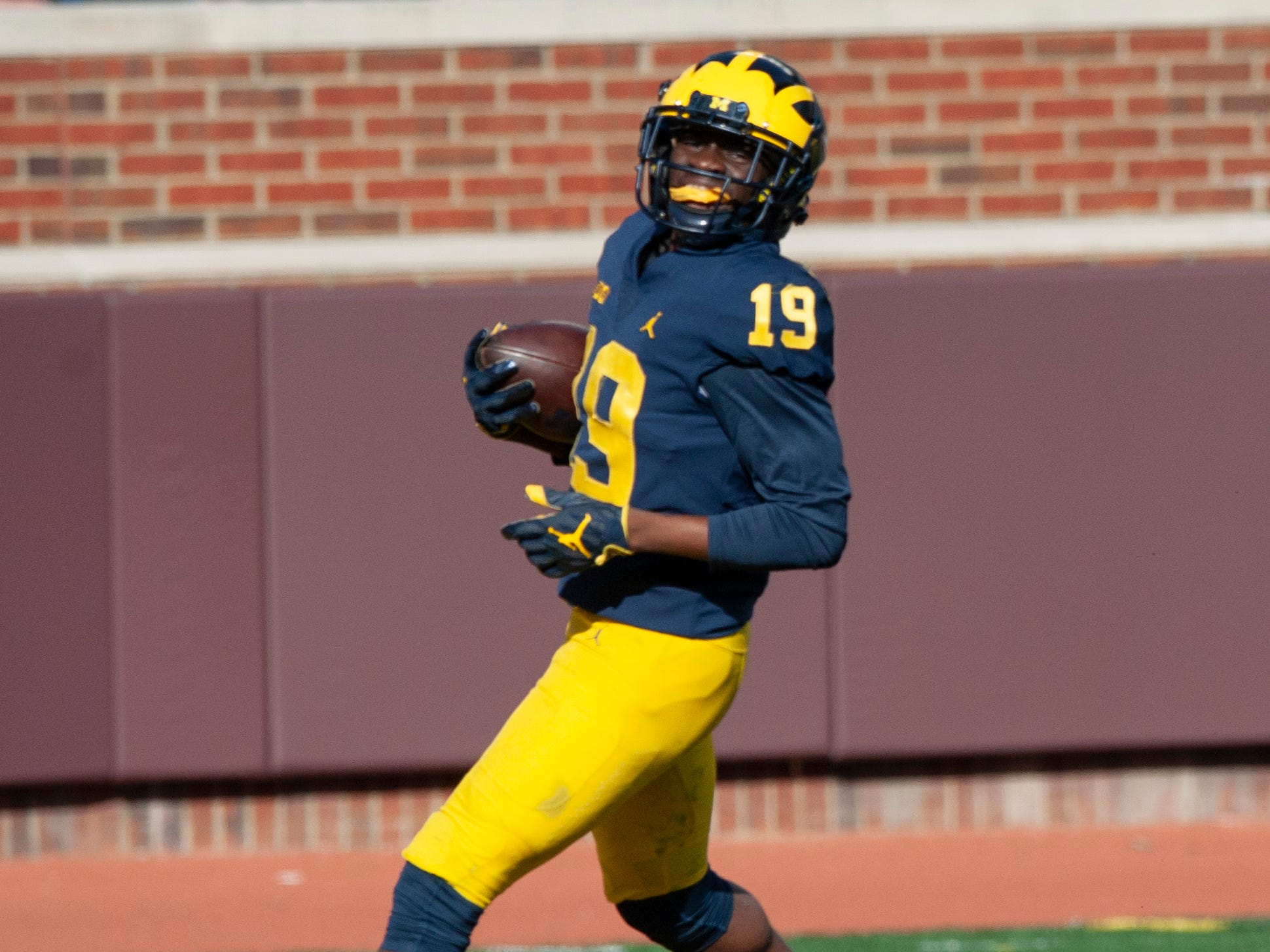 Michigan WR Mike Sainristil reaches the end zone on a pass reception for touchdown.