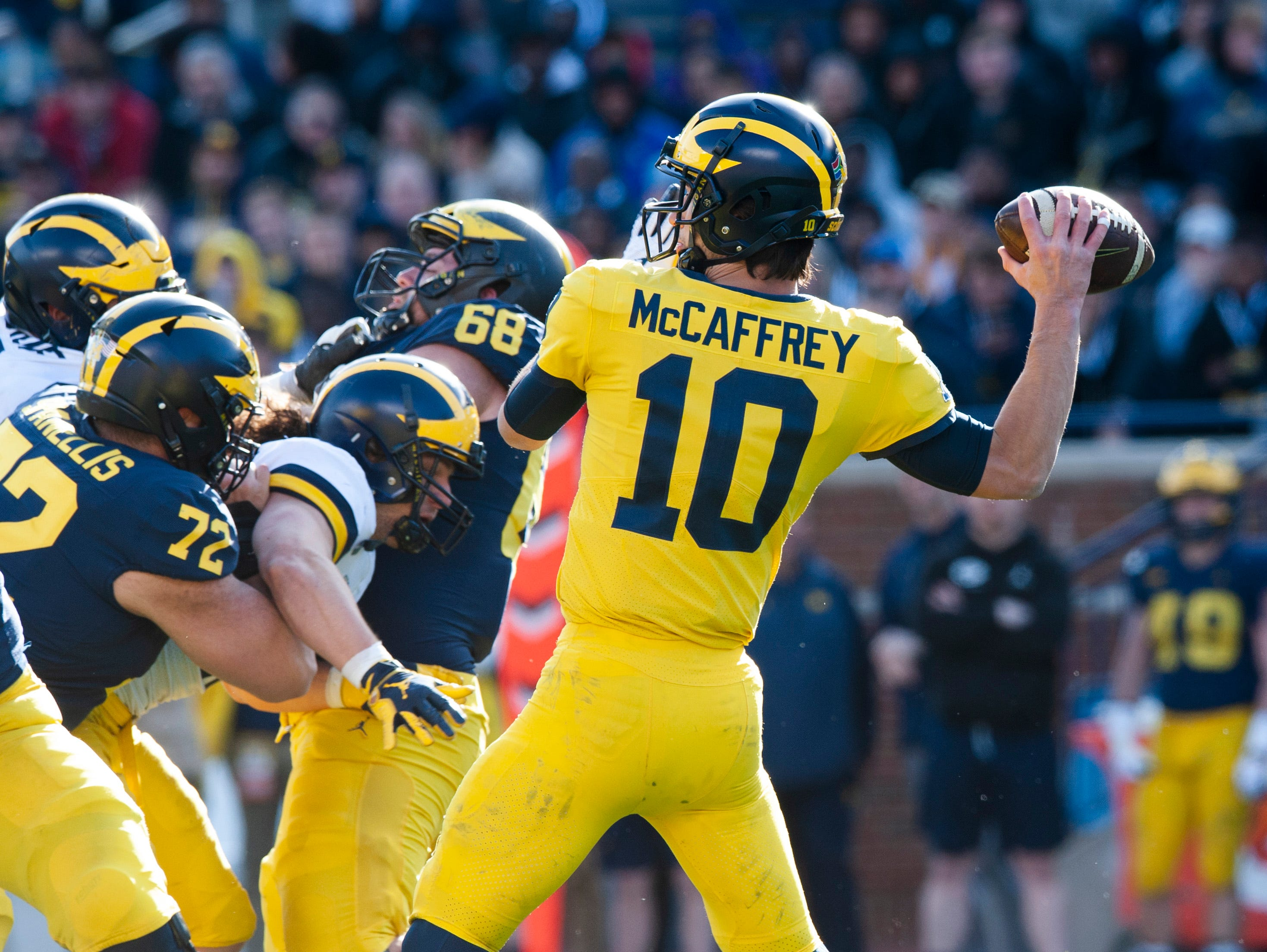 Michigan quarterback Dylan McCaffrey cocks his arm to throw a pass during the 2019 Spring Game at the Big House.